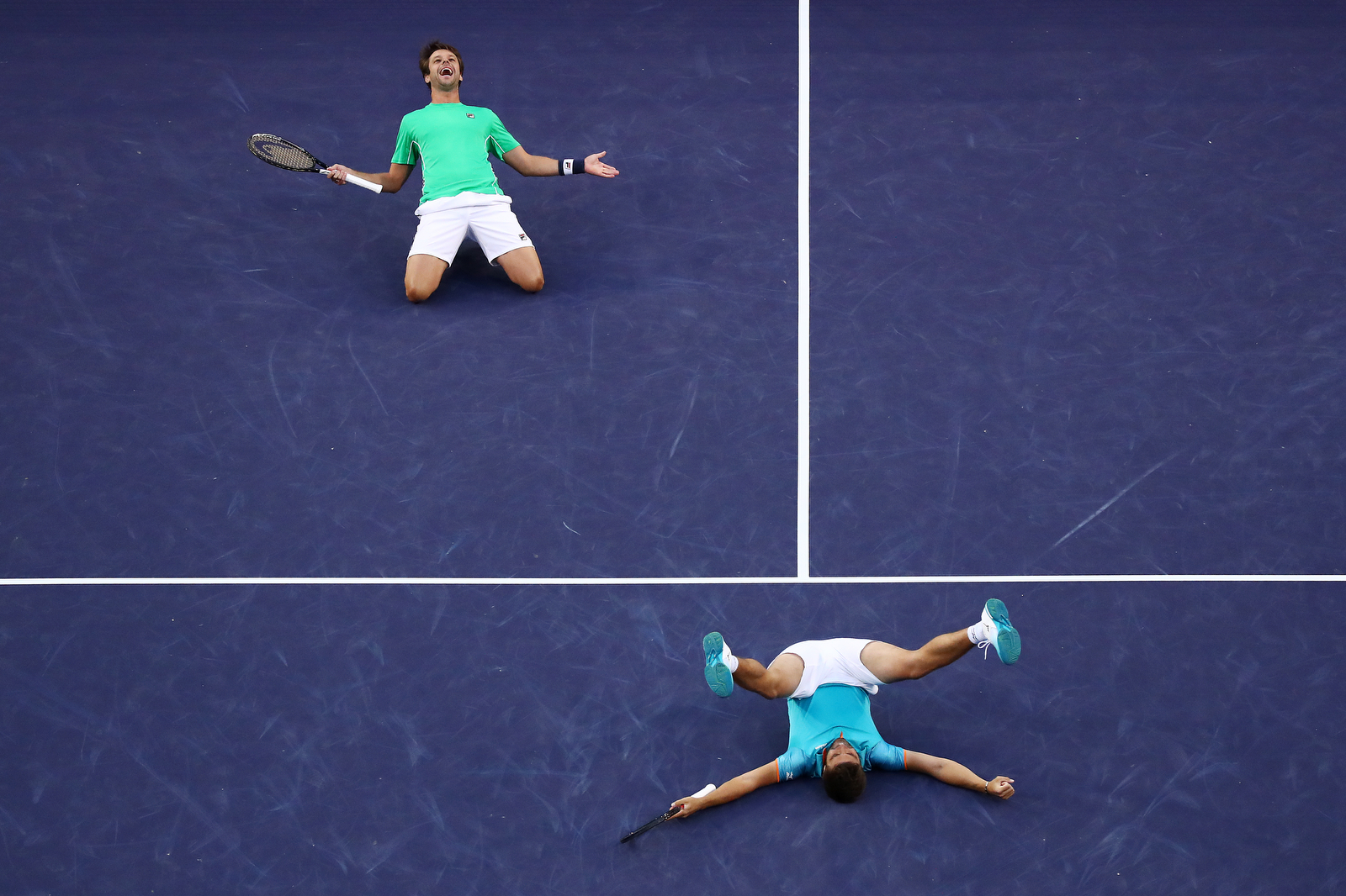 INDIAN WELLS, CALIFORNIA - MARCH 16: Nikola Mektic of Croatia and Horacio Zeballos of Argentina celebrate their men's doubles final match victory against Lukasz Kubot of Poland and Marcelo Melo of Brazil on Day 13 of the BNP Paribas Open at the Indian Wells Tennis Garden on March 16, 2019 in Indian Wells, California. (Photo by Yong Teck Lim/Getty Images)