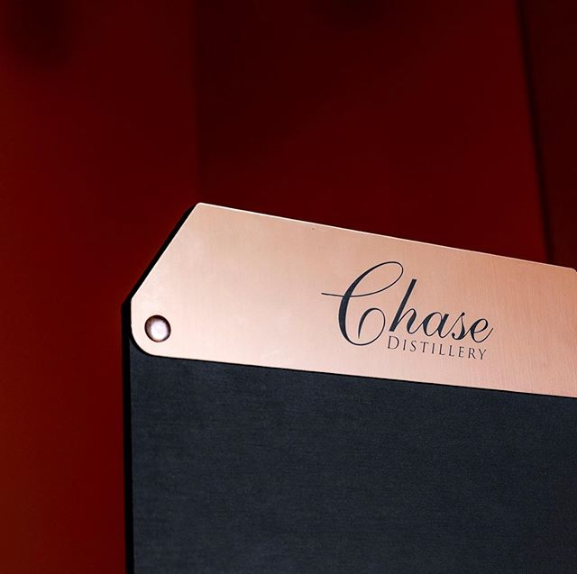 We produced 1500 of these 2-bottle blackboards for Chase Distillery last month. A combination of stained beech, double sided blackboard and lasered copper finish acrylic are assembled with copper rivets and a a screenprint was done on the front. Its simple but effective for displaying their 2 key products and adding a personal message. . . . @chase_distillery #copper #blackboard #wood #design #laseretch #cnc #pos
