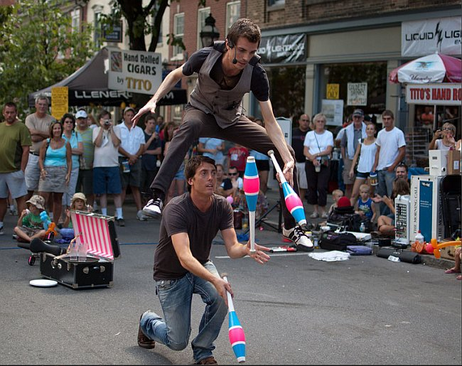 Performing tricks in the street for tips