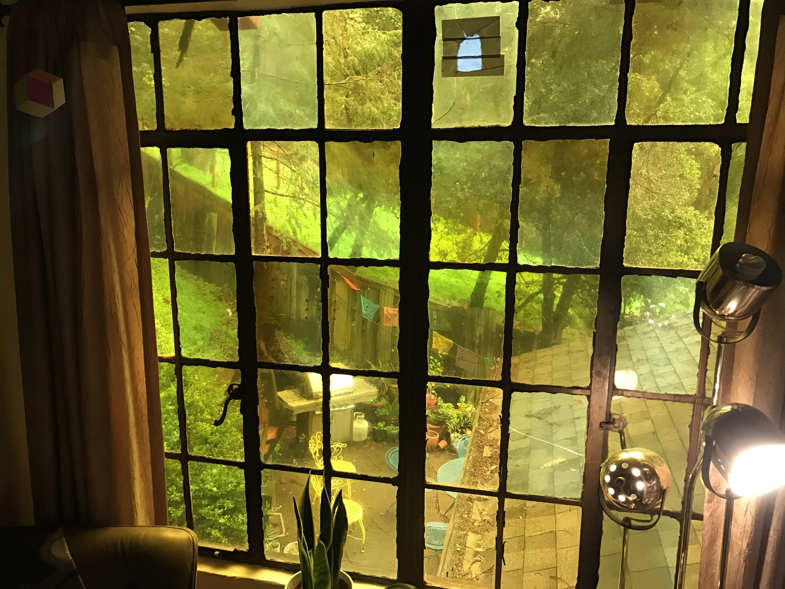 Certain windows have the darkest yellow glass, like this Southeastern bedroom wall. The depth of coloring in the amber glass seems to be sorted by their compass directions with the lightest shades facing Northwest.