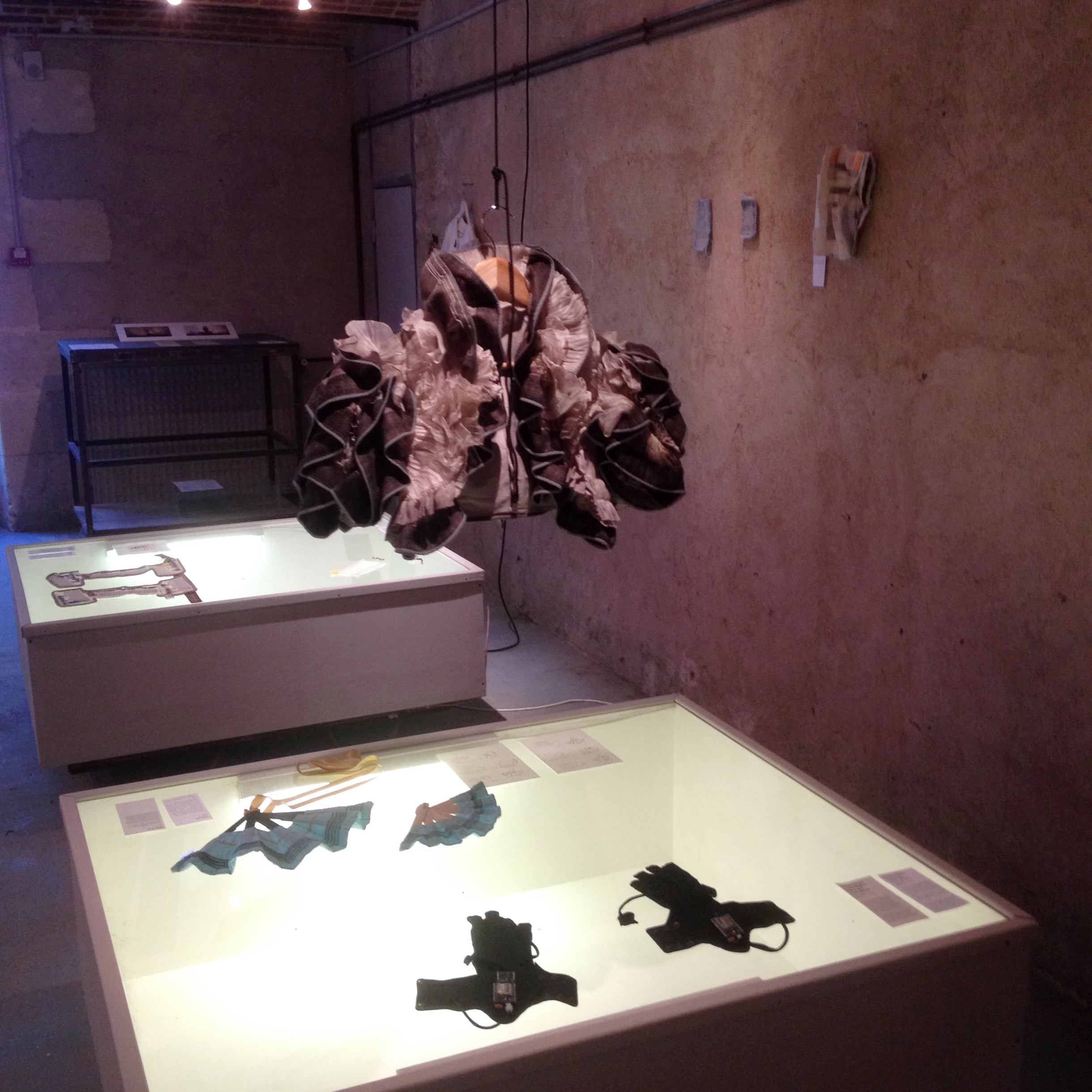 Imogen Heap's sound-reactive bolero and a pair of mi.mu gloves  in the wearables exhibition in Palliard
