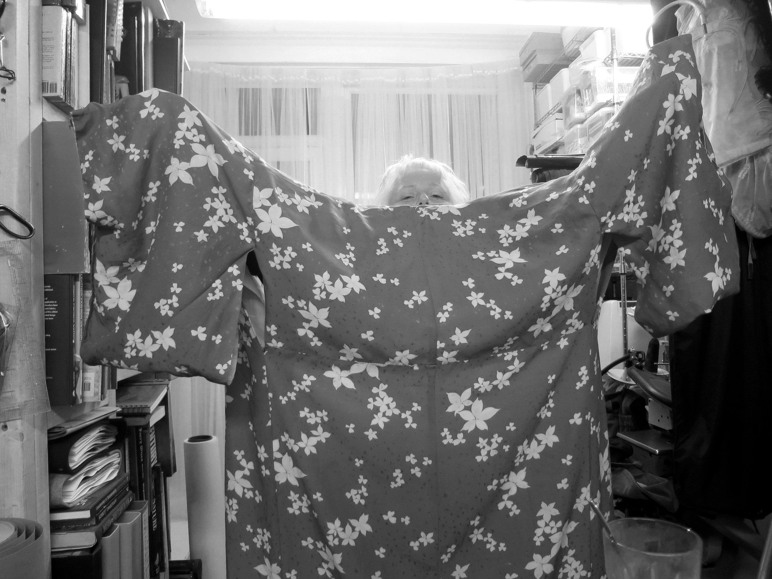 Aste fixes her kimono