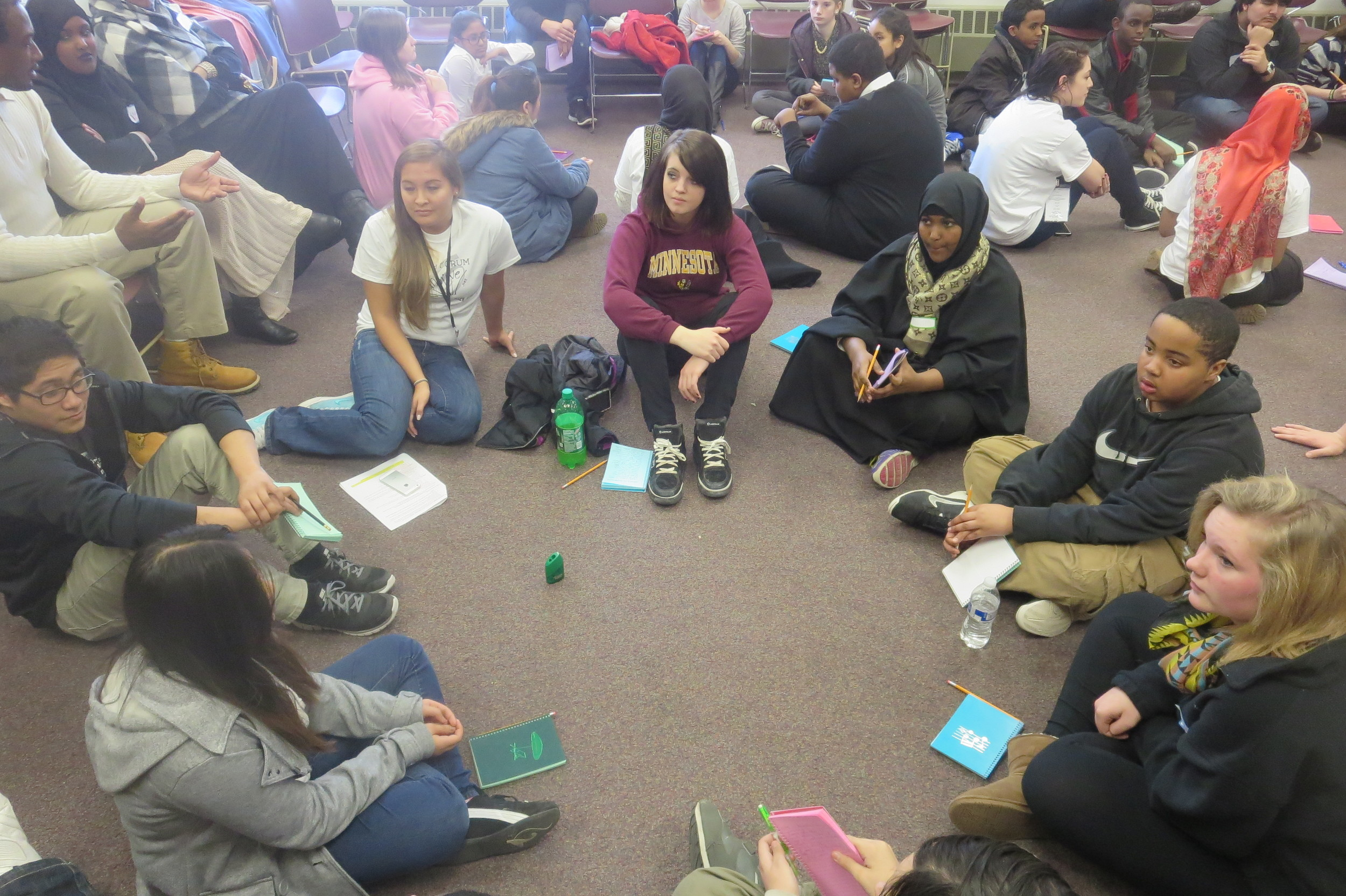 Students discussing social justice and getting ready to create a poetry mural
