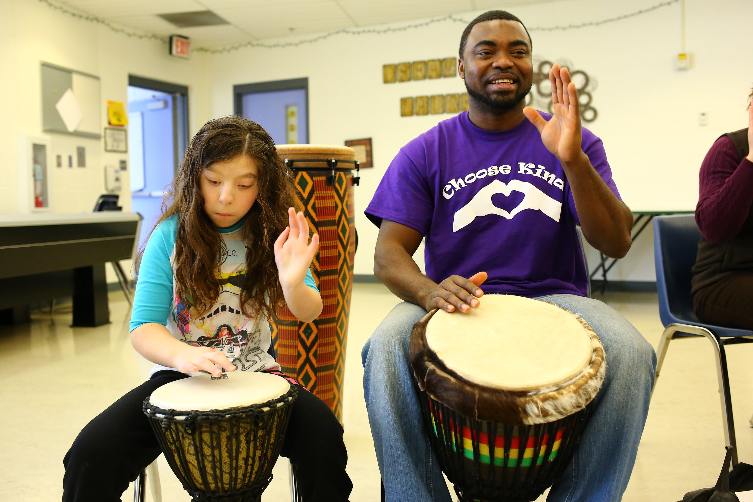 Growing together: Christian Adeti and a student at the Minnesota Academy of the Blind practice their drumming technique