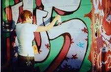 Katrina doing aerosol art.