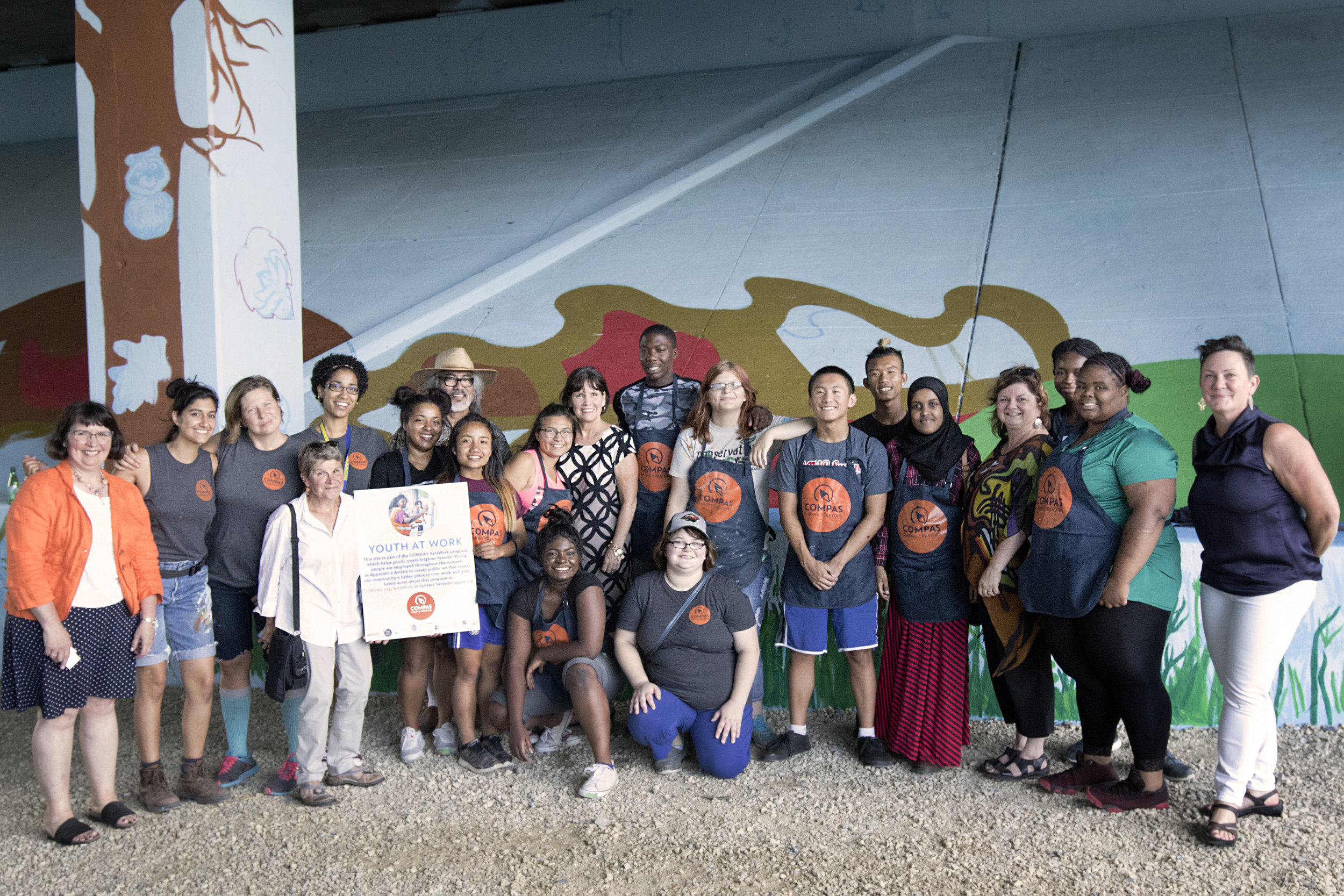 Youth at Work! ArtsWork Apprentices show off their mural-in-progress for a visit with Congresswoman Betty McCollum, Councilmember Amy Brendmoen, and other local leaders. Photo: Noah Linck