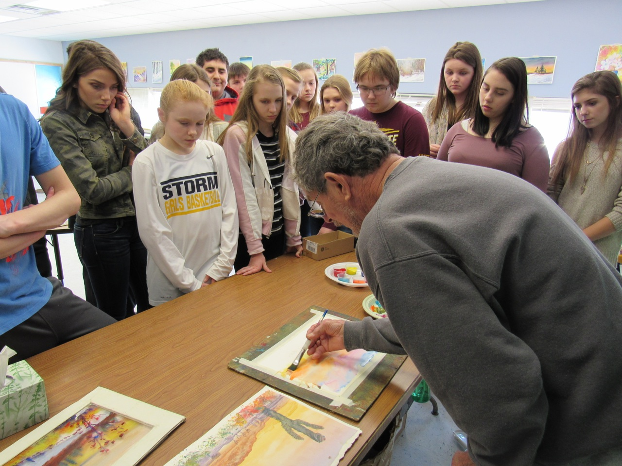 Jim Mondloch using watercolor with students