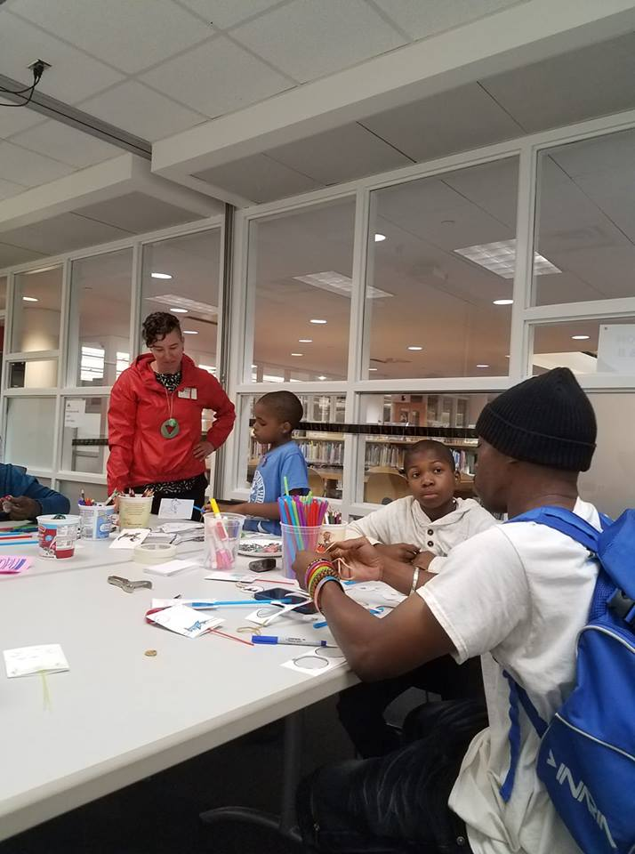 Kelley Meister making mini-movies with kids at Rondo Library