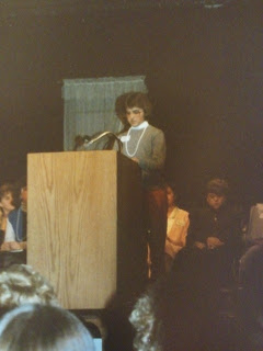 Sara reading her piece at the Landmark Center in 1986