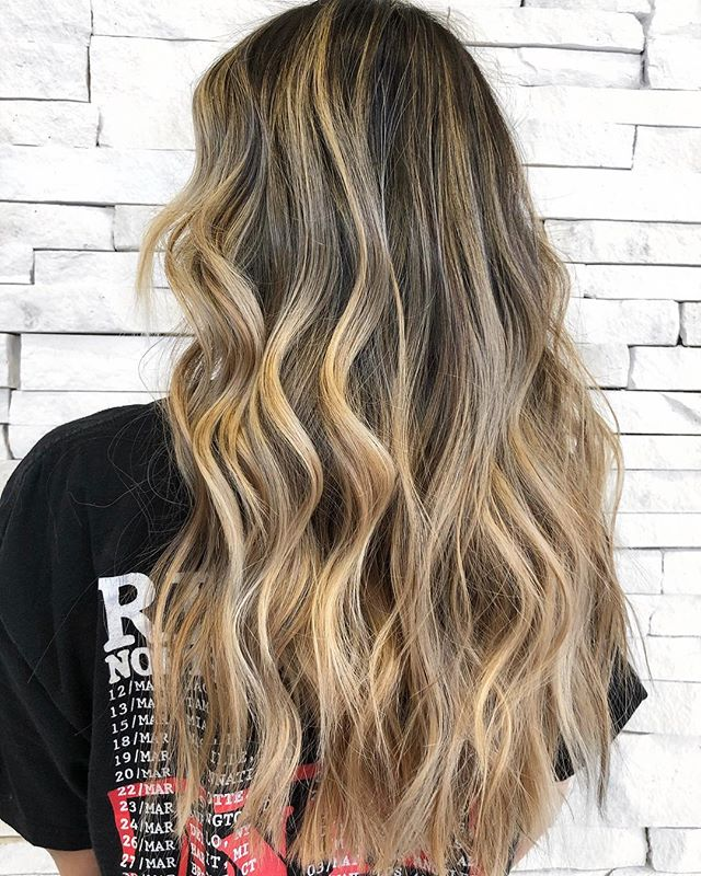 """BRUNETTES can be BLONDES too💁🏼♀️ -We used blondor and 20 volume to achieve our lift, using my signature foilyage technique. -We root shadowed with color touch 5/1 and 2"""" of /11 special mix -We toned all over with color touch 9/16 and 9/01 to avoid ashing the color out completely • • • #btconeshot19_warmbalayage #btconeshot19_curls"""