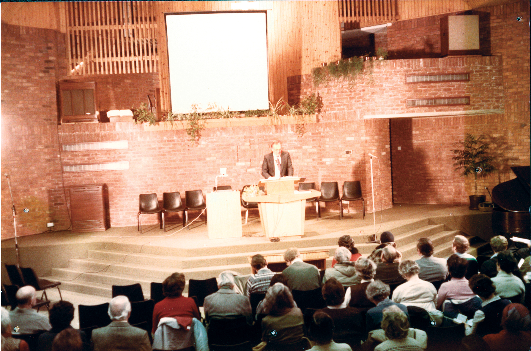 9-J preaching at church.jpg
