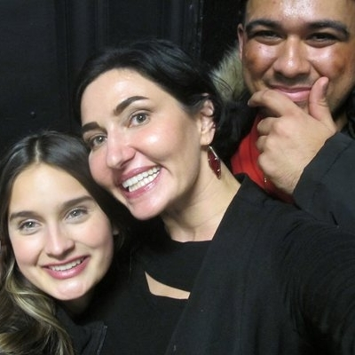 Eliza (middle) with her students
