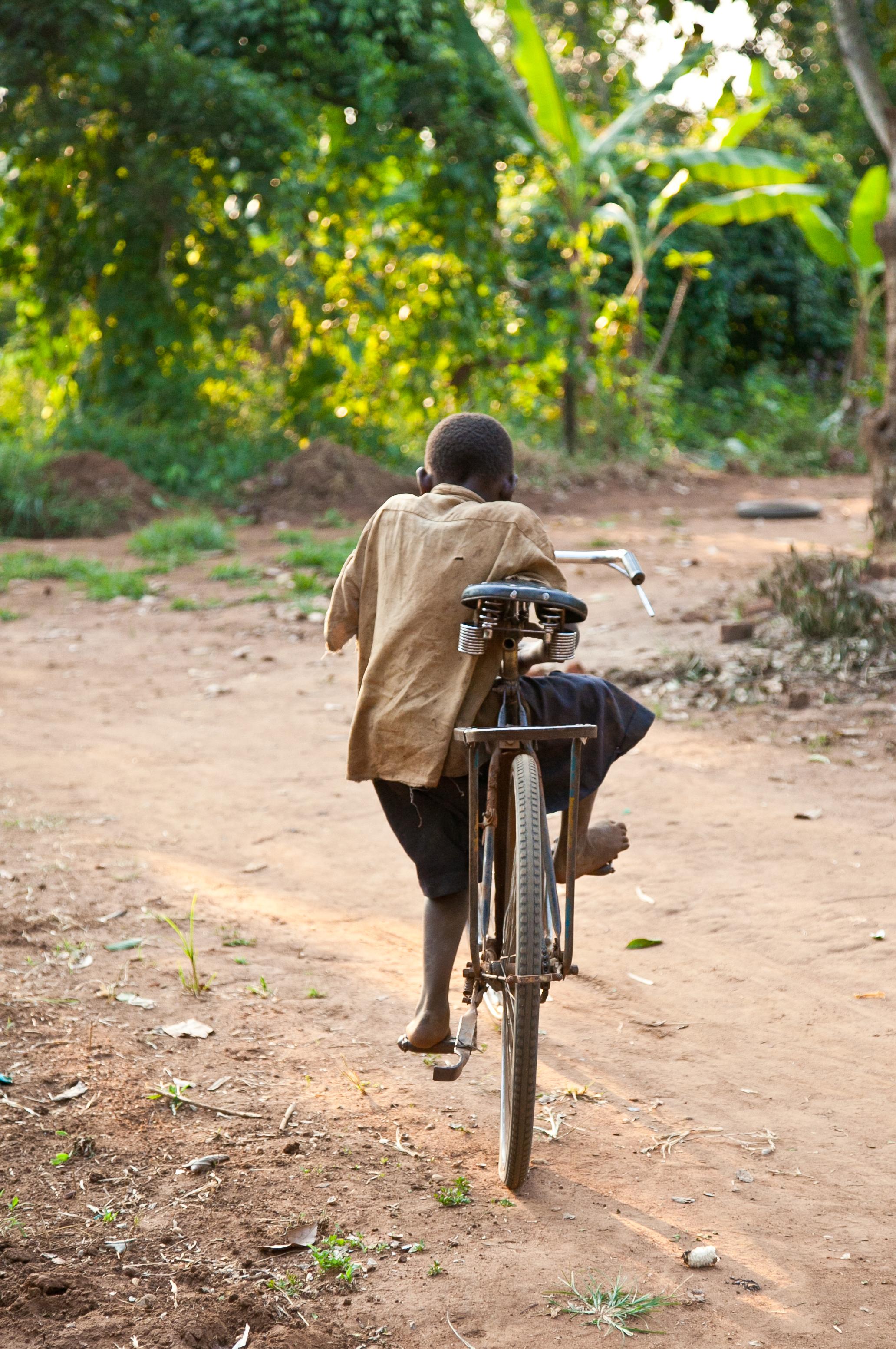 trisa-taro-bike-riding-village-uganda.jpg