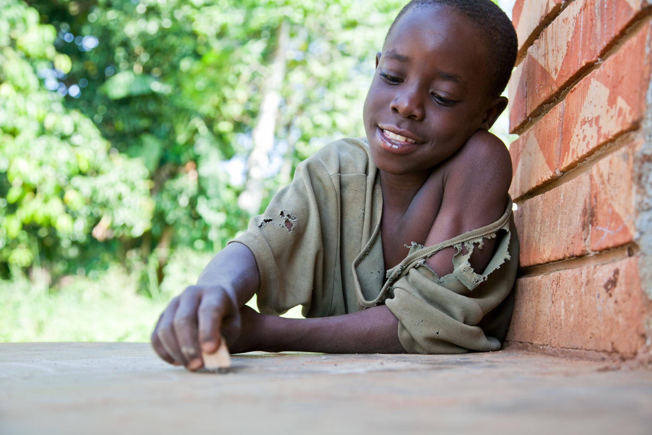 trisa-taro-G-writing-village-uganda.jpg