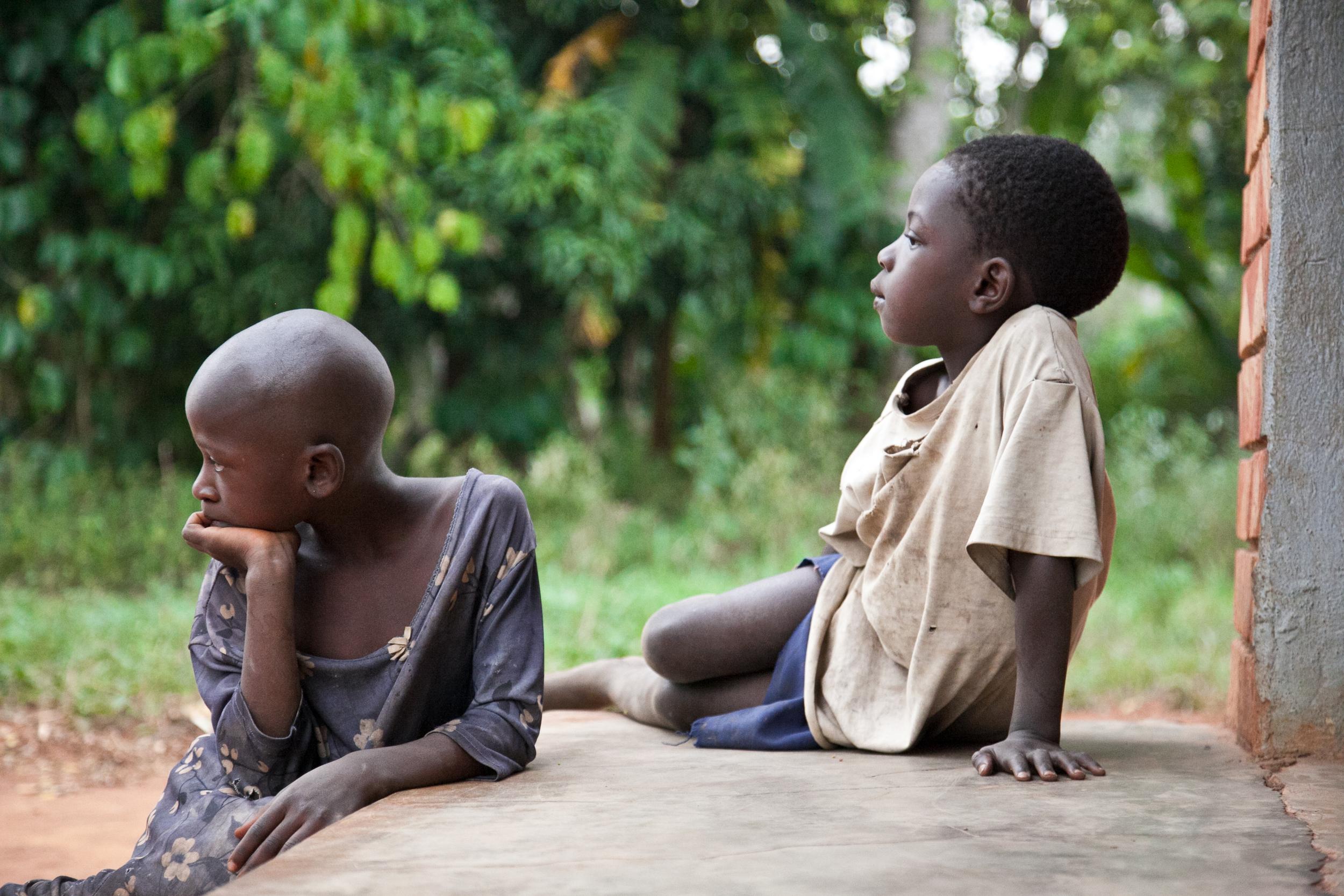 trisa-taro-girls-watching-village-uganda.jpg