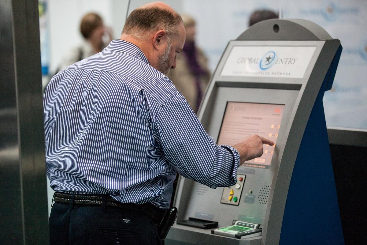 Arriving passenger at Newark Liberty Airport uses Global Entry kiosks