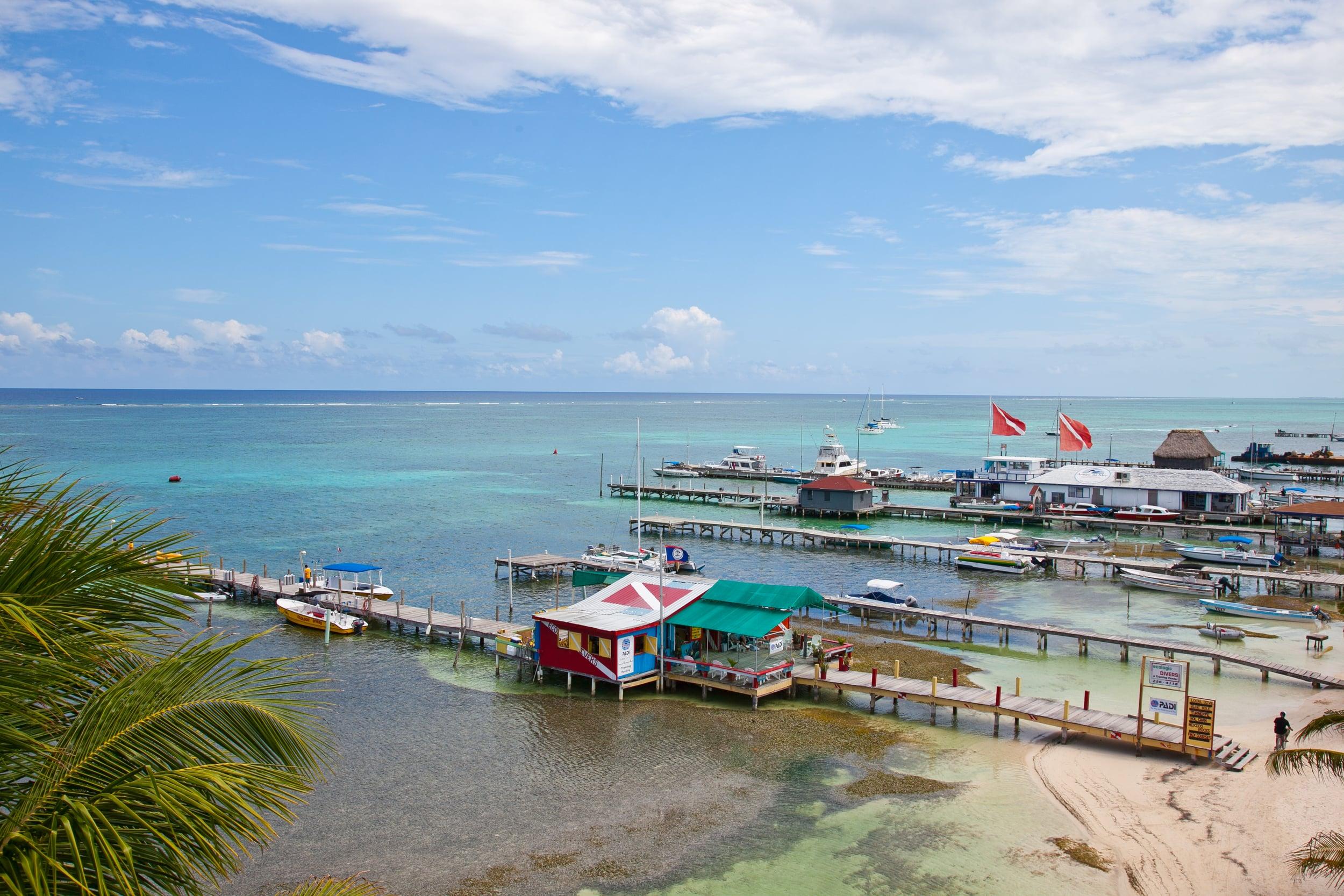 trisa-taro-beach-docks-ambergris-caye-san pedro-belize.jpg