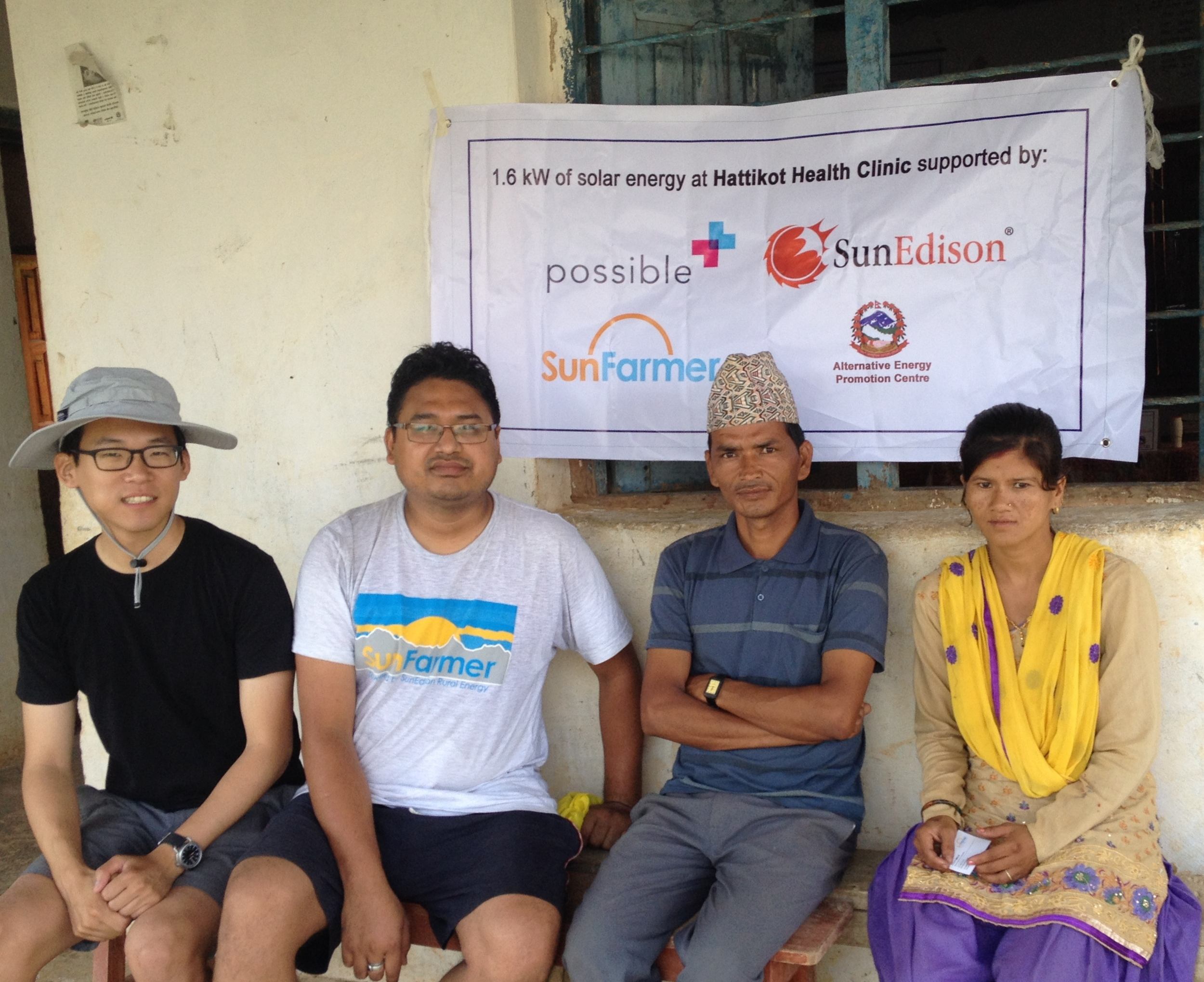 SunFarmer co-founder Andy Moon, Director of Engineering and Ops Avishek Malla, and staff members of Hattikot Health Clinic