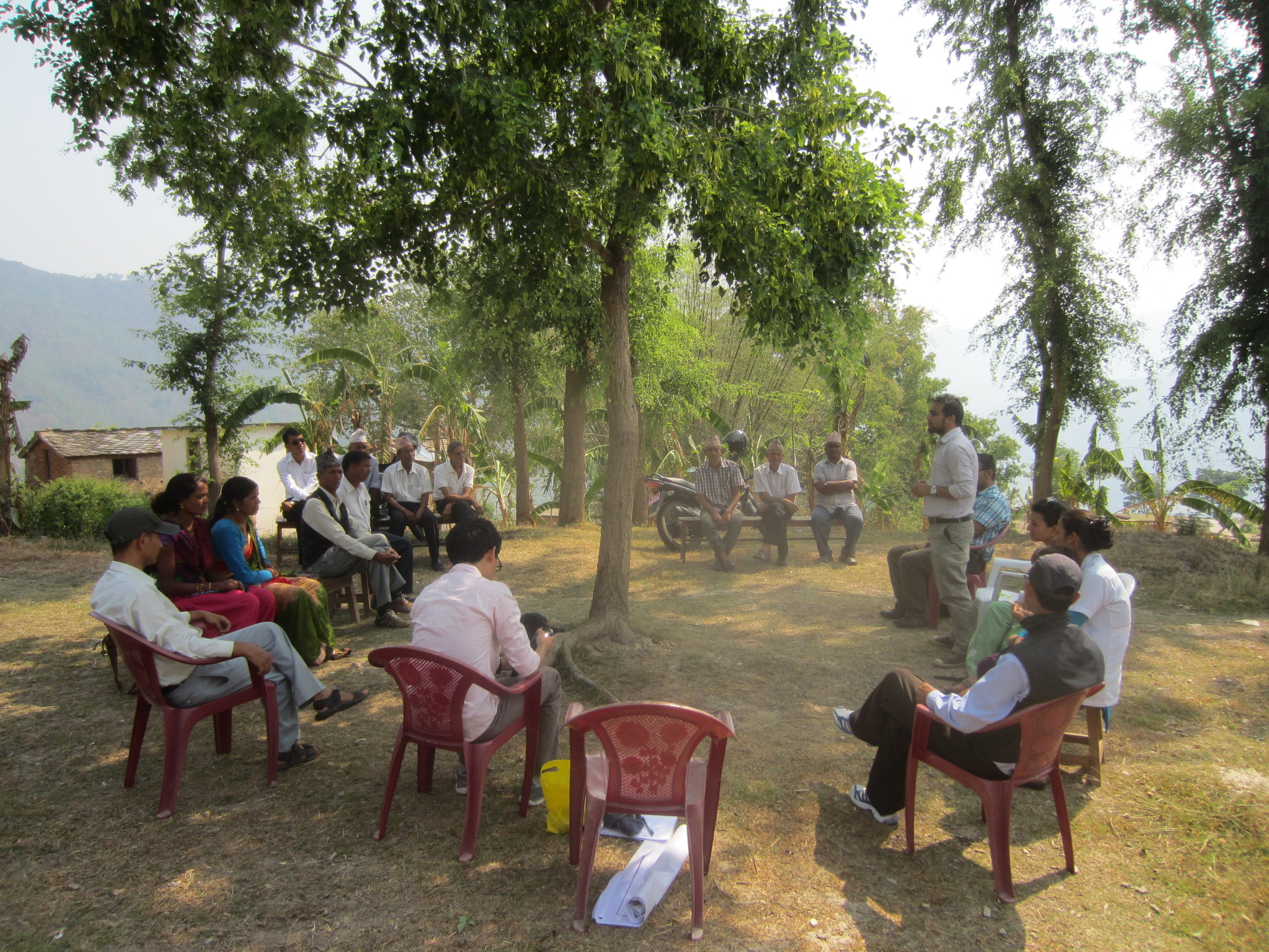 Amrit Banstola from Possible leading a community meeting to discuss the solar system at Shrikot Health Clinict