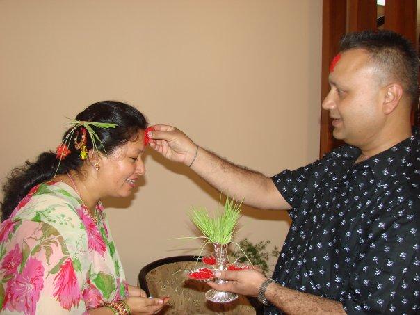 Receiving Tika Jamara on Dashain