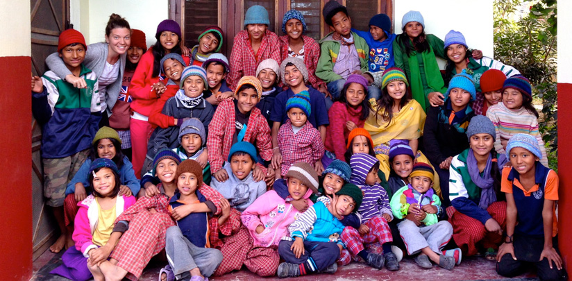 Maggie Doyne in 2014 with over 35of her adopted children.     photo courtesy of blinknow.org