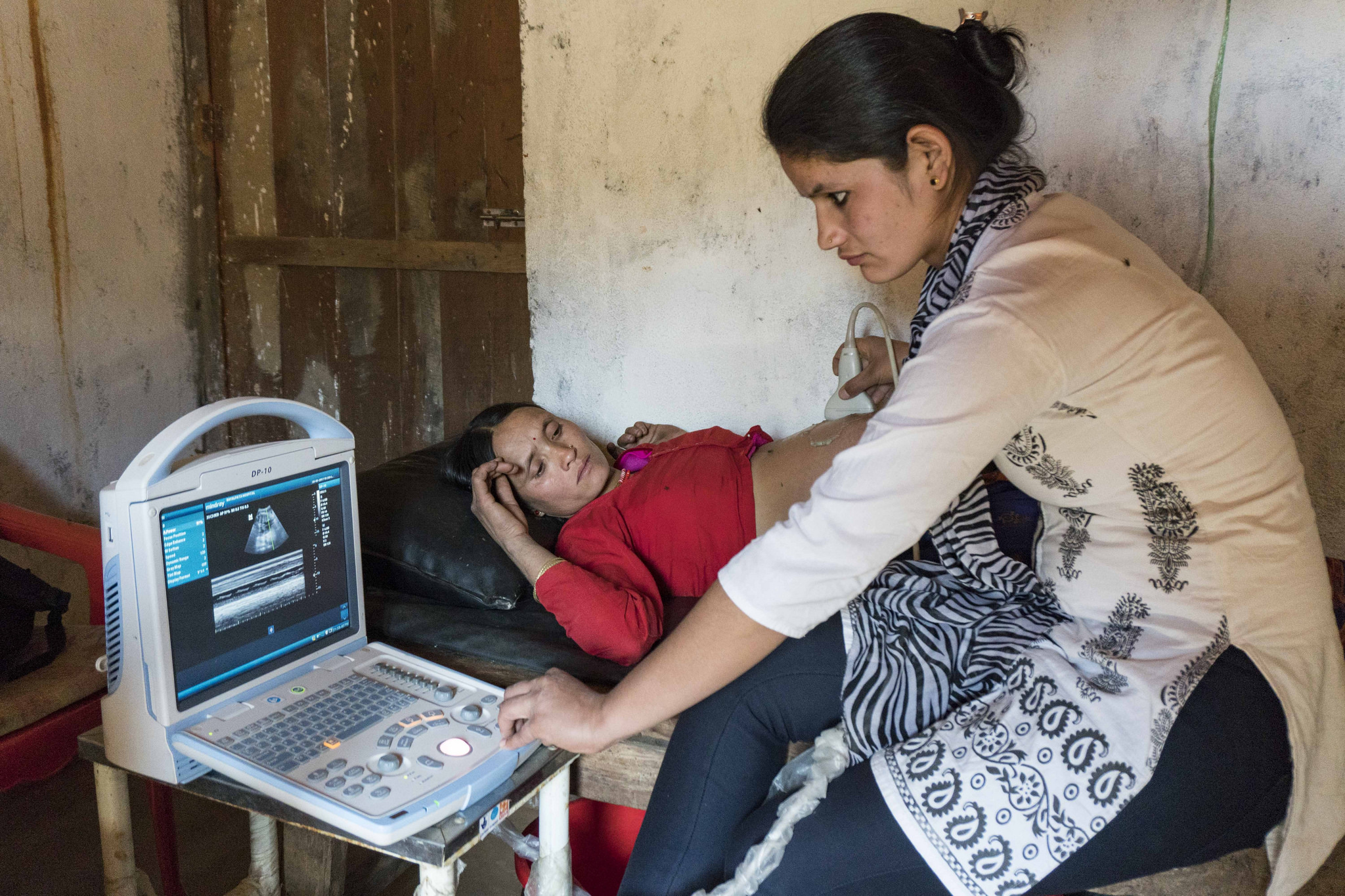 A patient gets an ultrasound at Lungra Health Clinic.