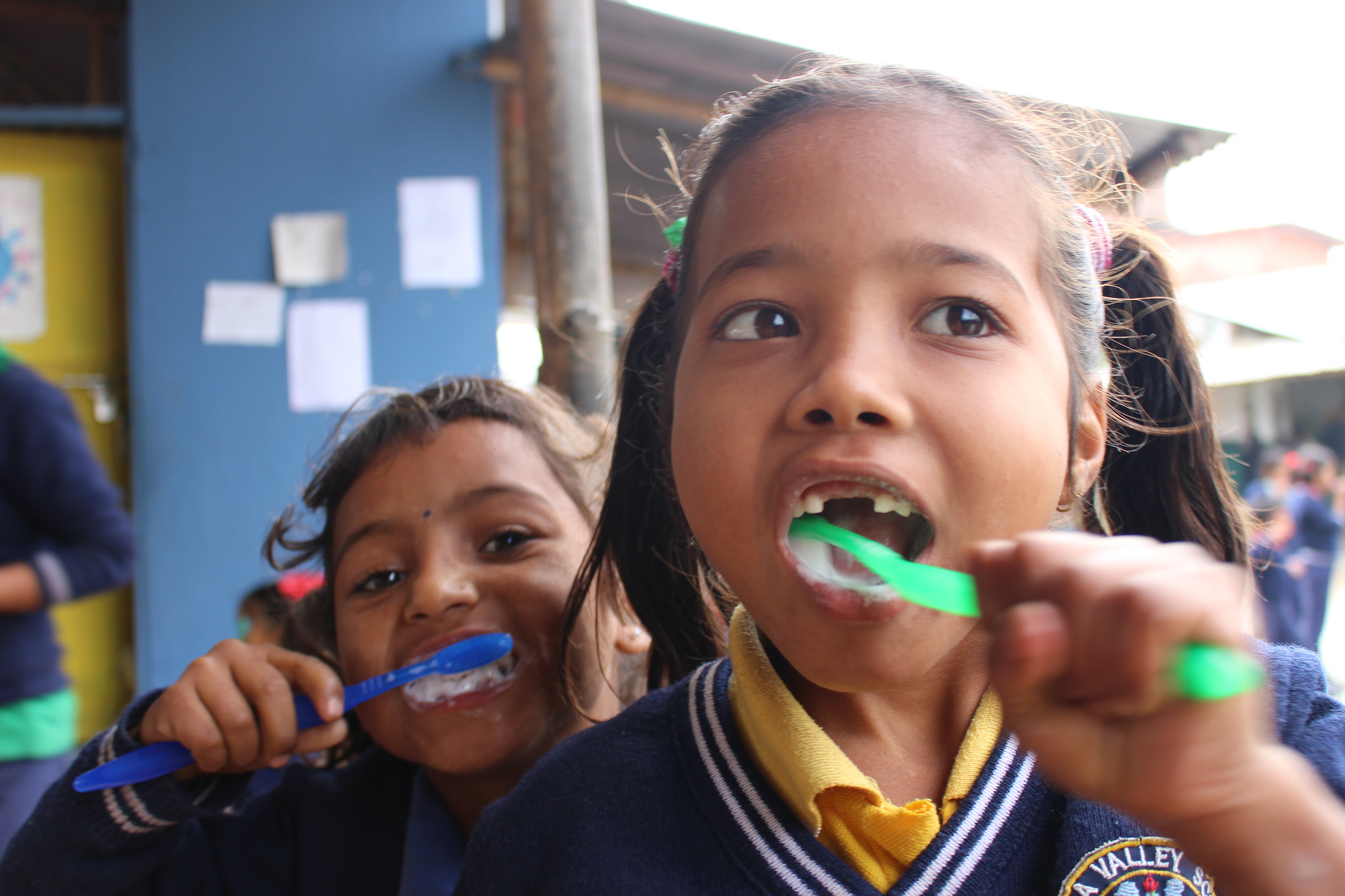 Children at Kopila Valley brushing their teeth.