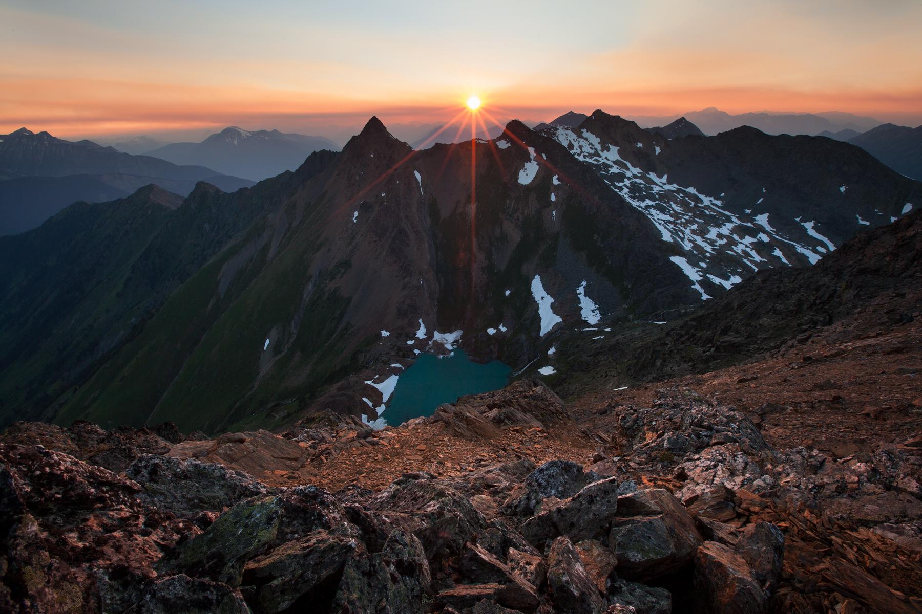 The sun sets over Crystal Peak near D'Arcy, B.C, Canada.  Image ©Connor Stefanison