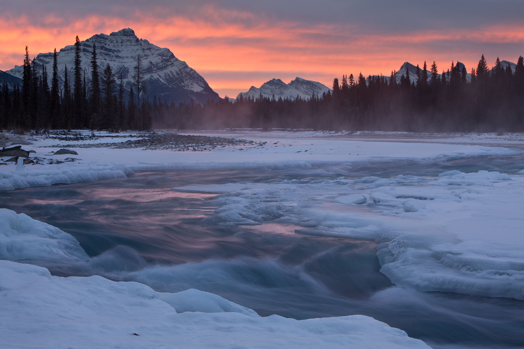 Sunrise on the Athabasca River in Jasper National Park, Canada.  Image ©Connor Stefanison