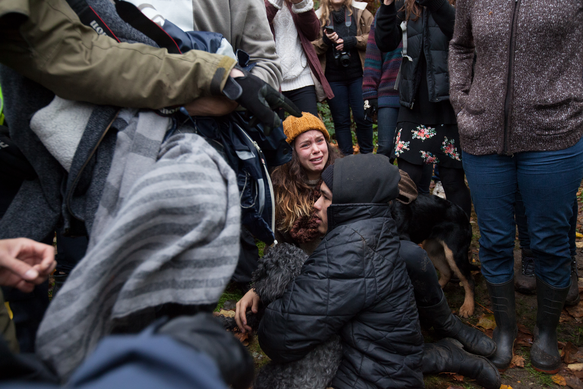 Protestors fall to the ground after getting caught up in a frenzy of police and other protestors.