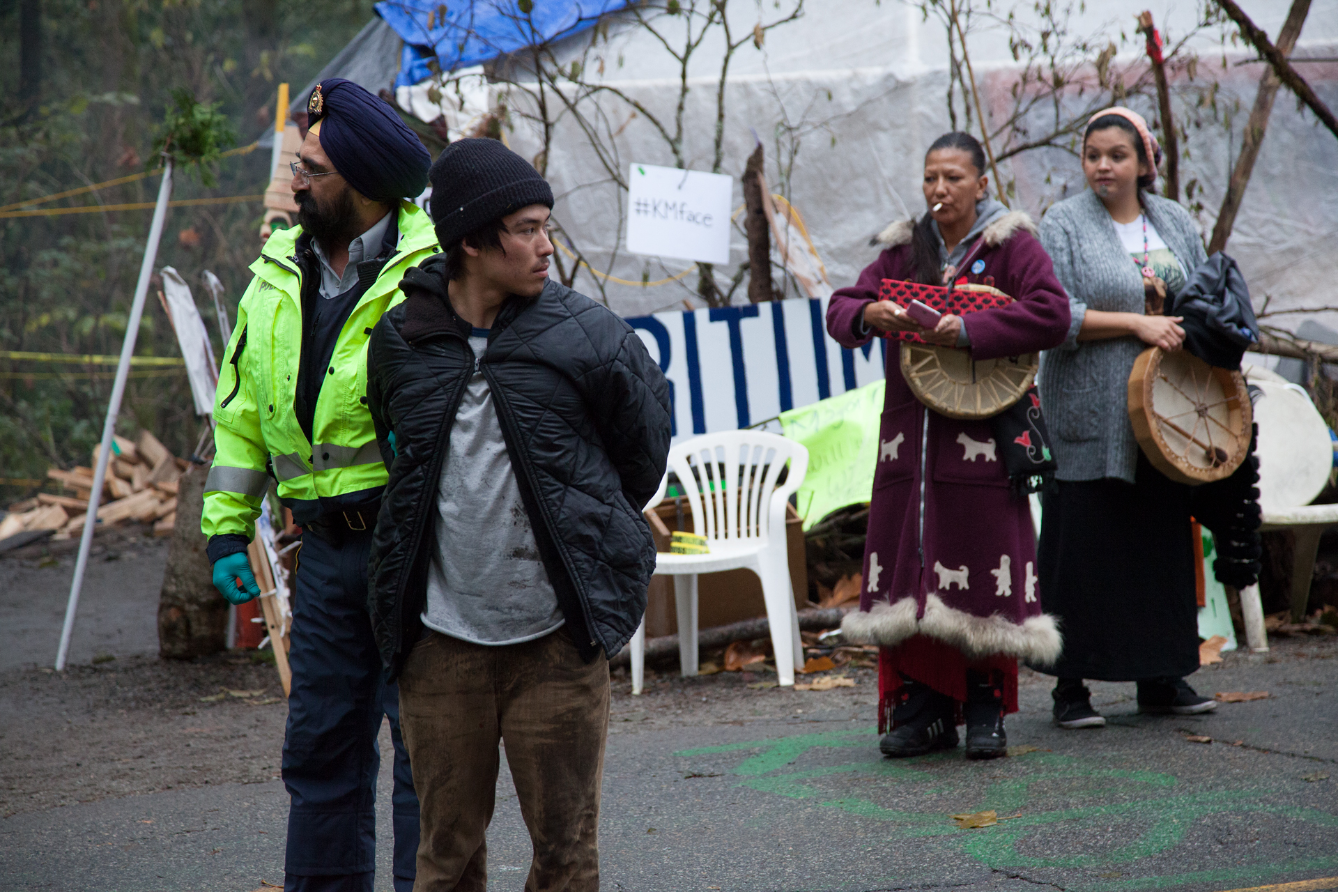 Tamo Campos, an environmental activist and grandson of David Suzuki, was pulled across the injunction line by police and arrested.