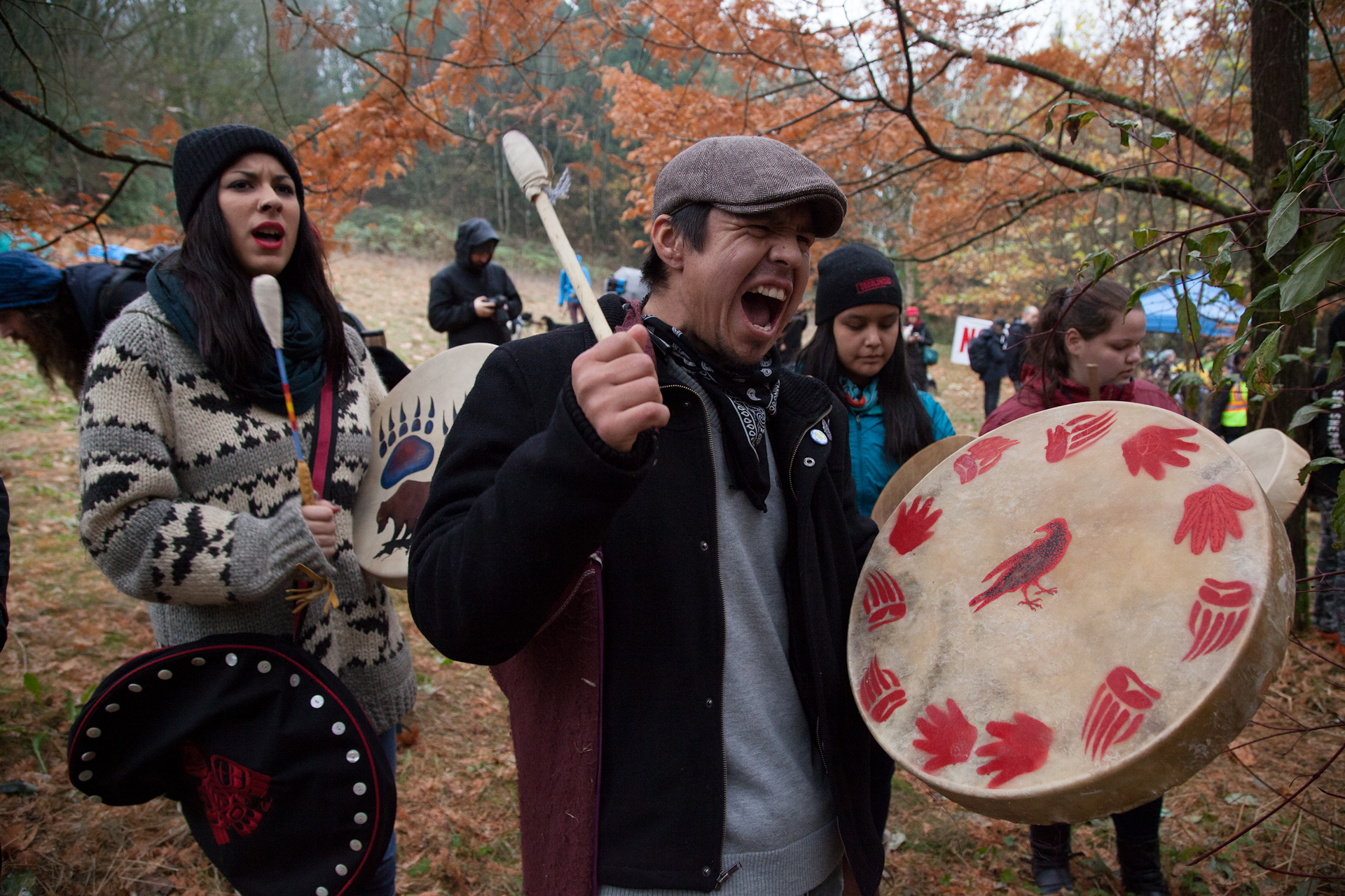 A protests began to get heated, a First Nations man begins to sing in anger of Kinder Morgan.