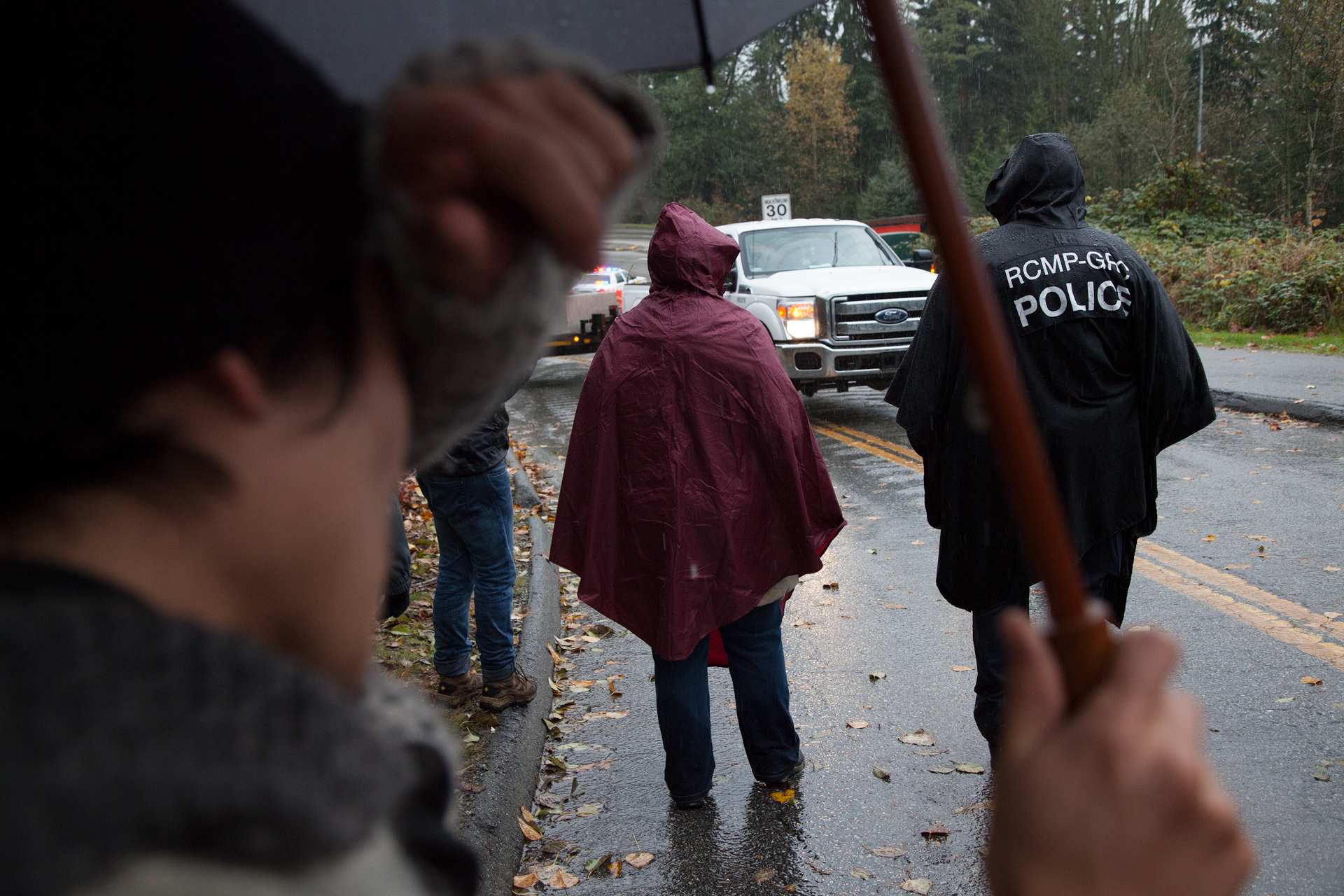 A protestor has a sigh of relief as Kinder Morgan trucks turn around after protestors blocked the road to the borehole sites.