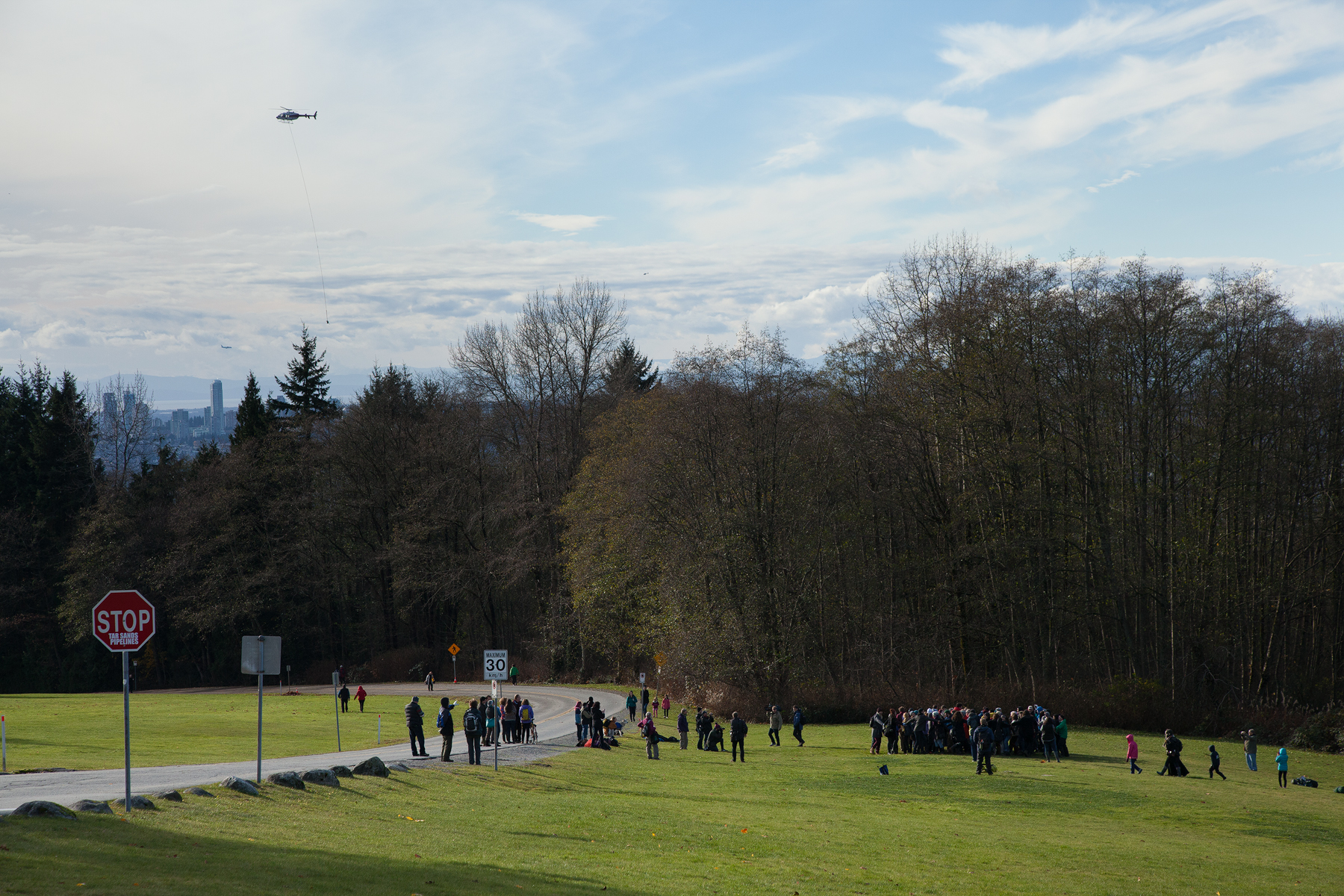 Protestors dance in joy as Kinder Morgan runs out of time to survey and leaves the mountain. The Kinder Morgan Helicopter flies above, bringing equipment from the mountain, back to their facilities.  The story is not over though. No final decisions have been made.
