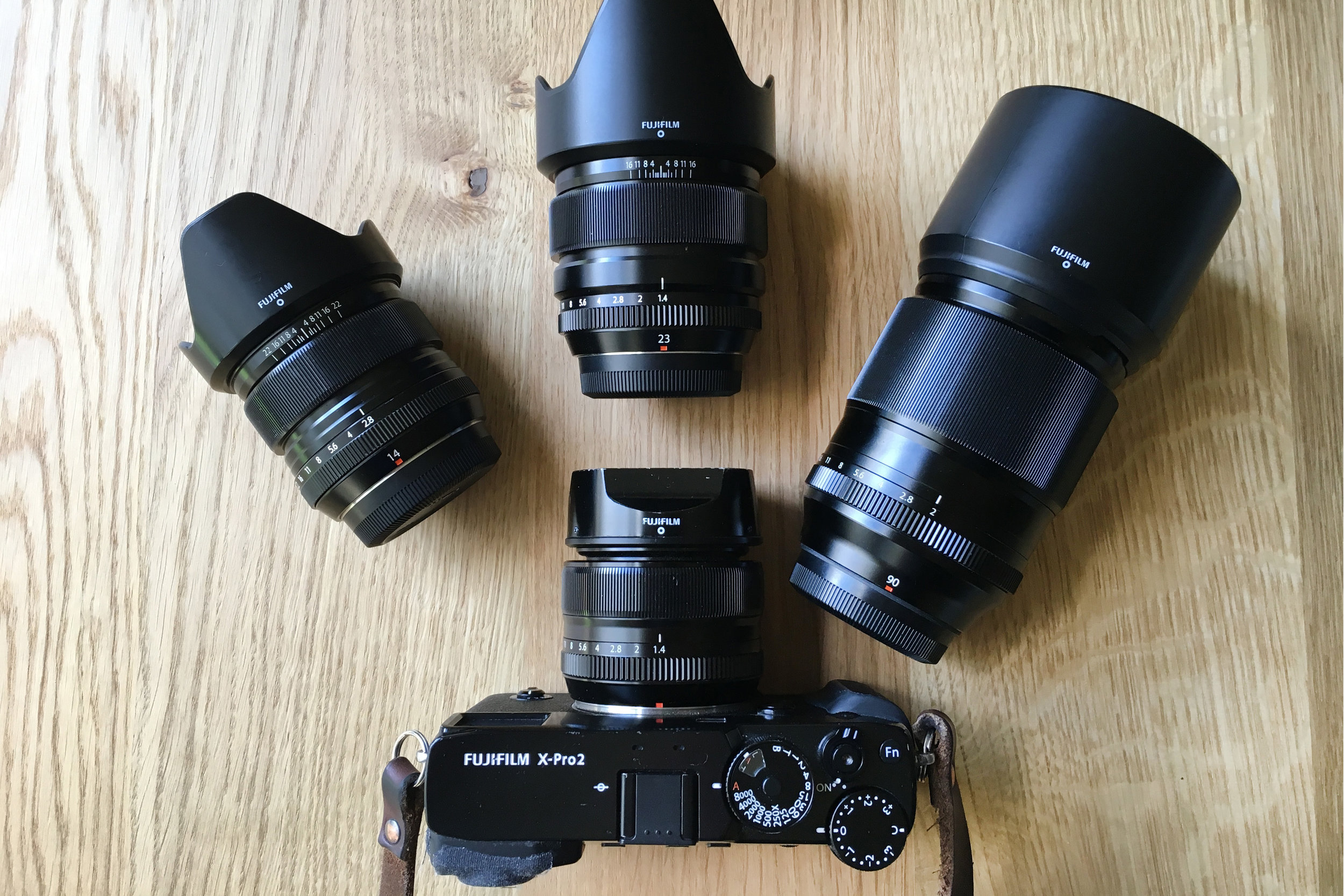 My current setup for travel. Fujifilm X-Pro with  XF 35mm f/1.4 R  mounted. From left to right;  XF 14mm f/2.8 R ,  XF 23mm f/1.4 R ,  XF 90mm f/2 R WR