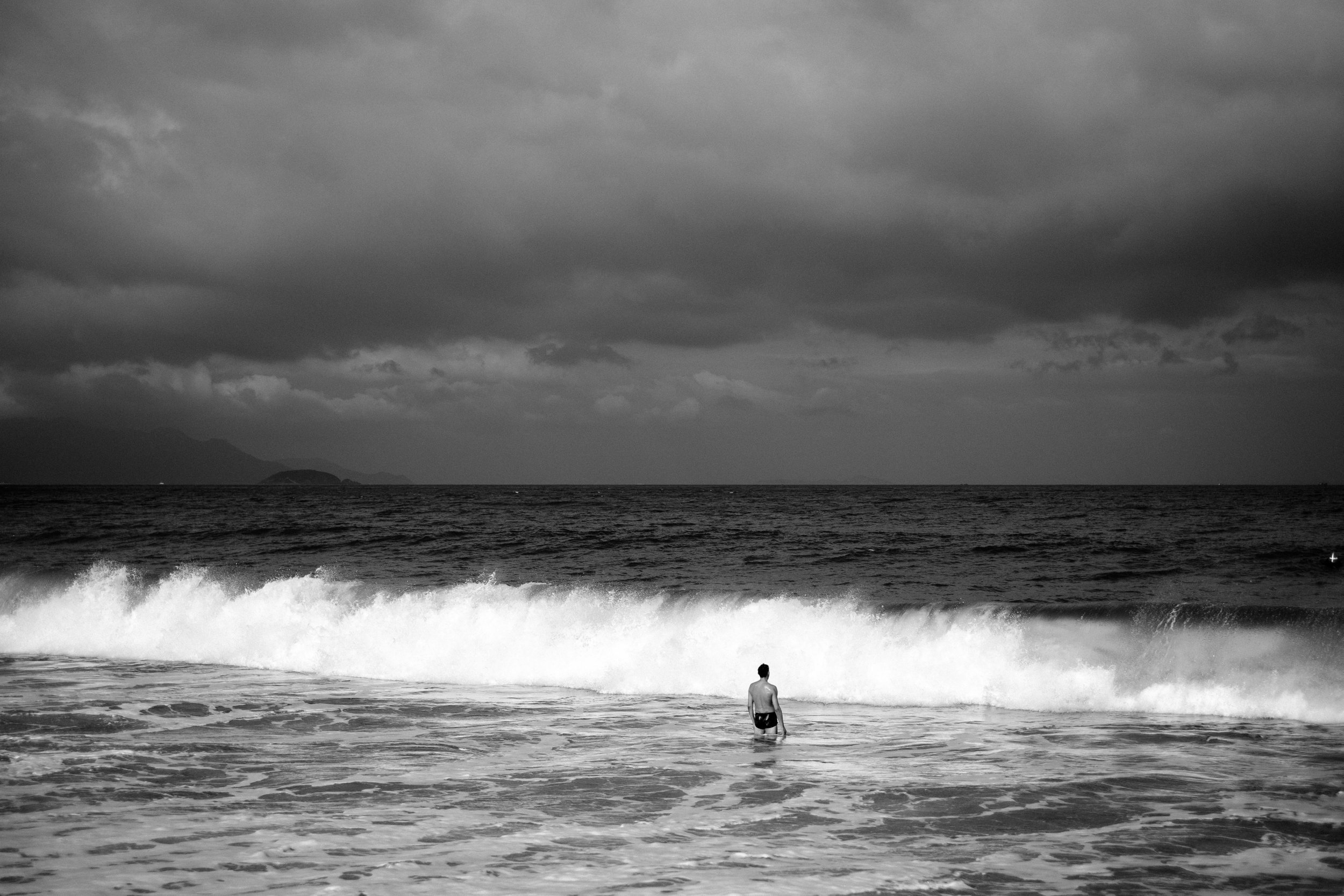 The man and the wave. Nha Trang,  Vietnam    FUJIFILM X-Pro2,    XF 35mm f/1.4 R
