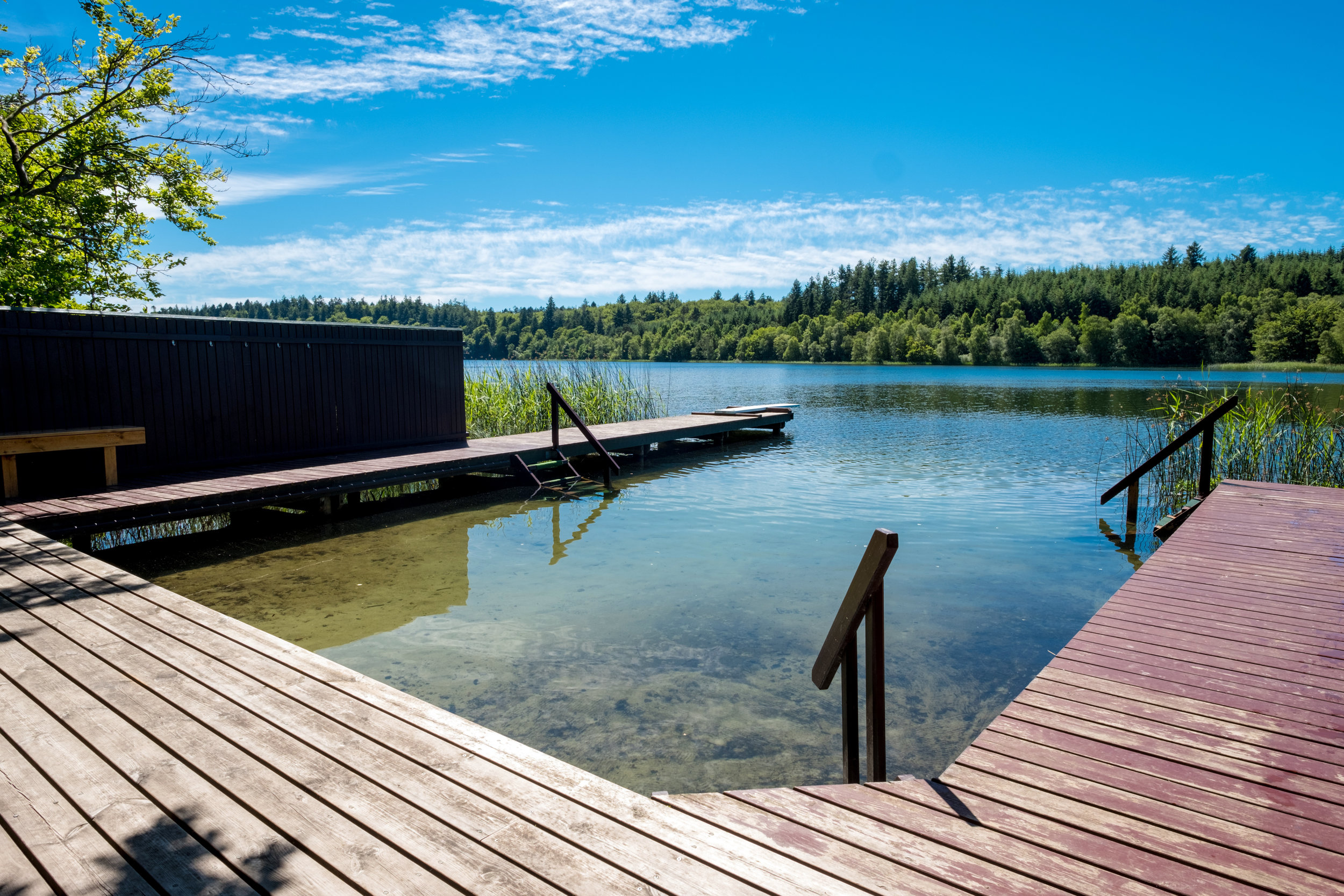 As a kid I visited Lars, Michael and Charlotte in Silkeborg almost every summer. We would visit this favourite spot of mine (Degnebadet). It is a private club, so I had to swim along the lake in order to see it again. Di handed me the camera over the fence so that I could take this quick snap. Definitely one of those spots which are huge in your memory but in reality small in scale. We had such good times here.