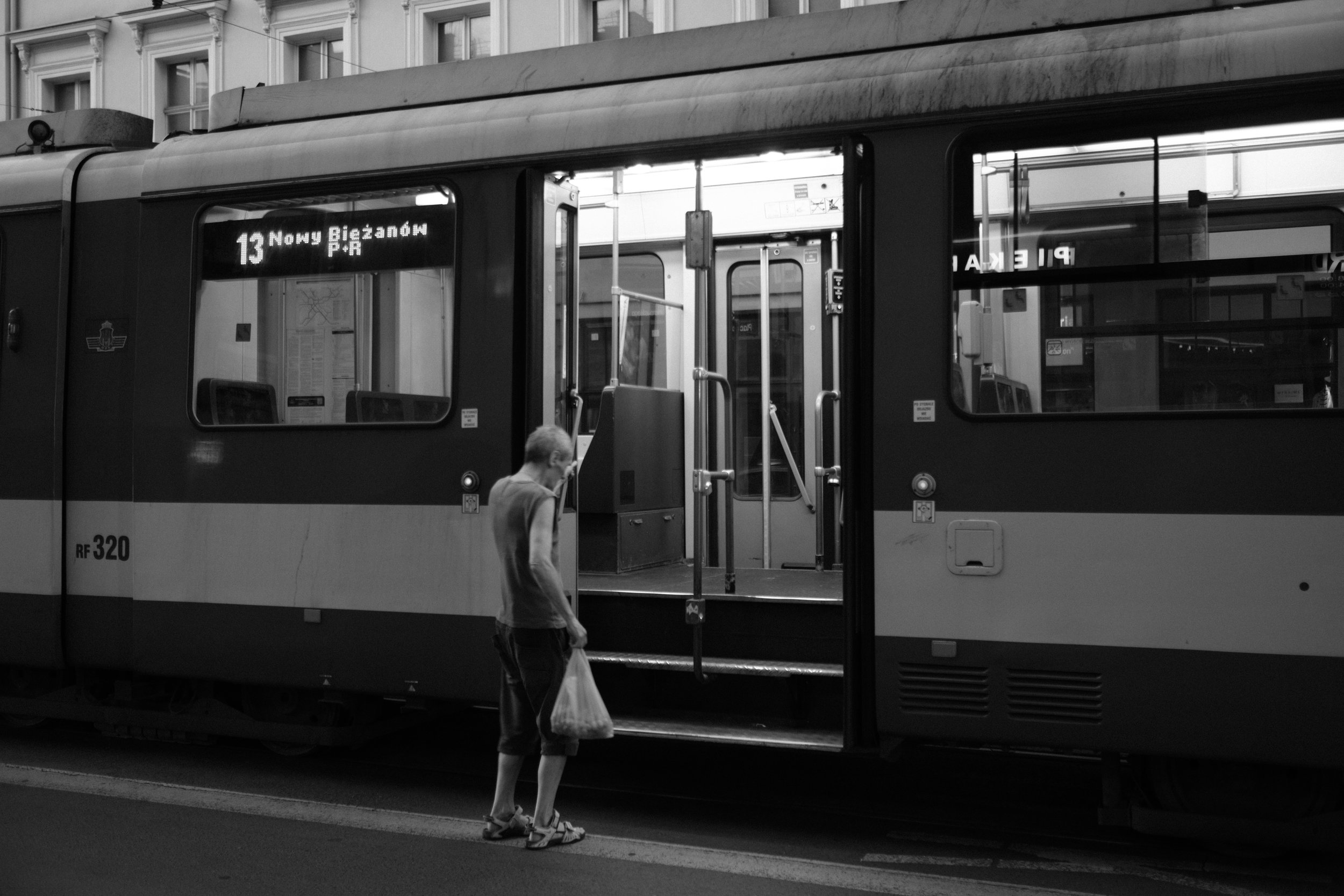 A man is entering a tram in Krakow Poland