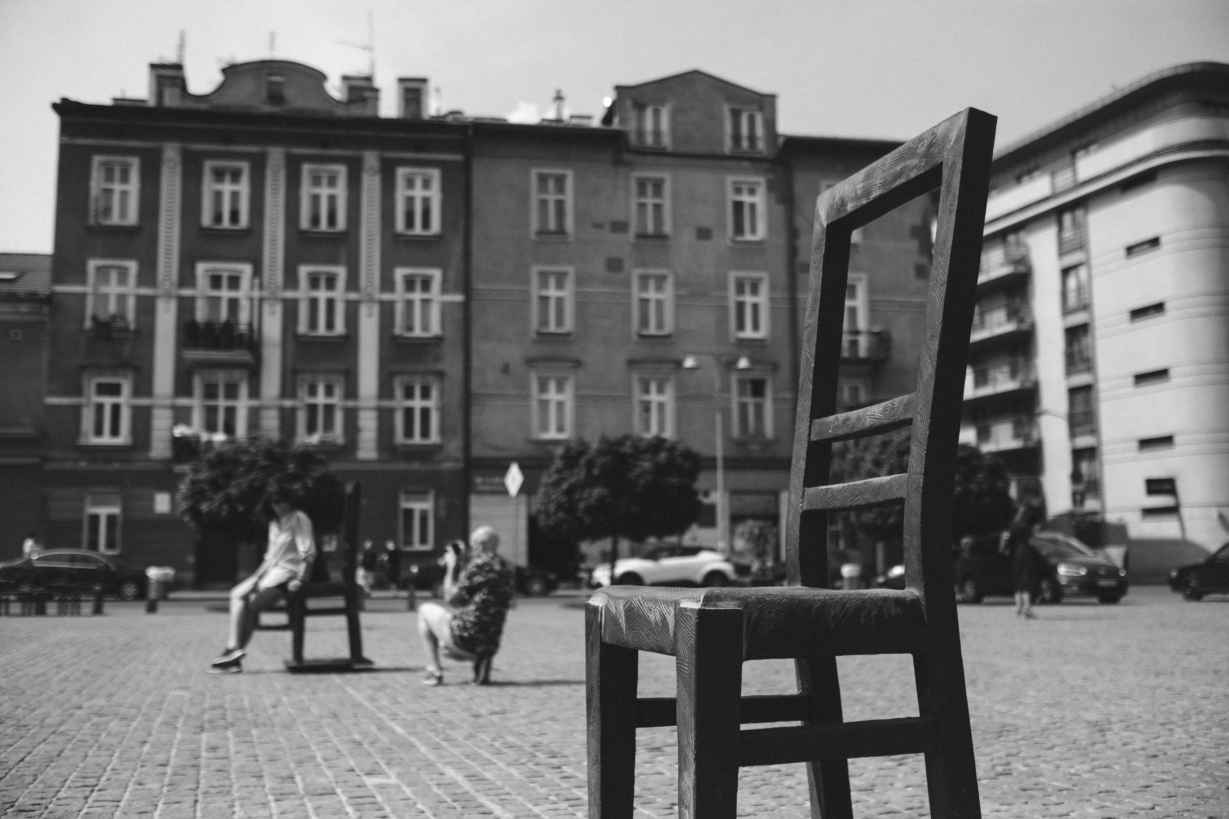 A large chair places in a square in the Jewish Quarter of Kazimierz in Krakow Poland