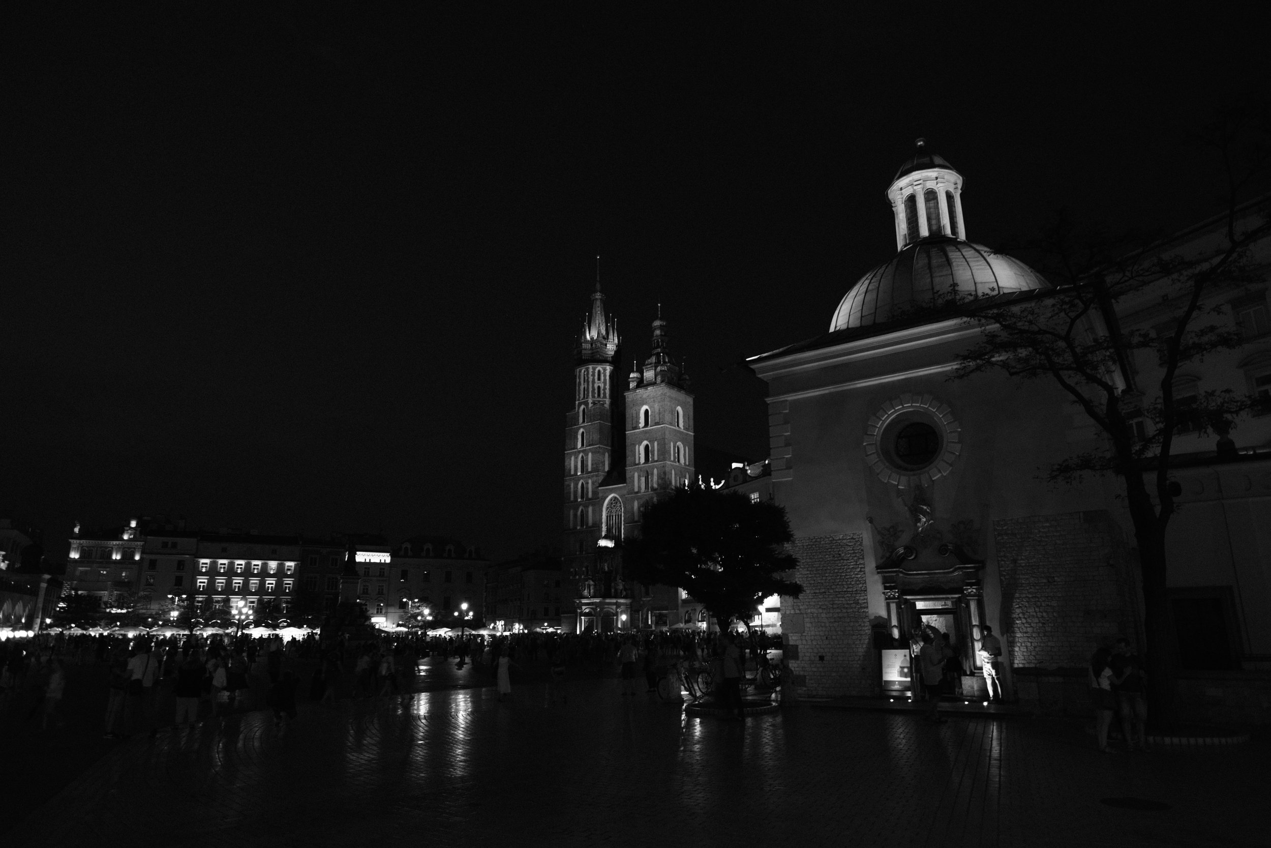 Evening scene with St. Mary's Basilica in the Main Square of the Old Town in Krakow, Poland