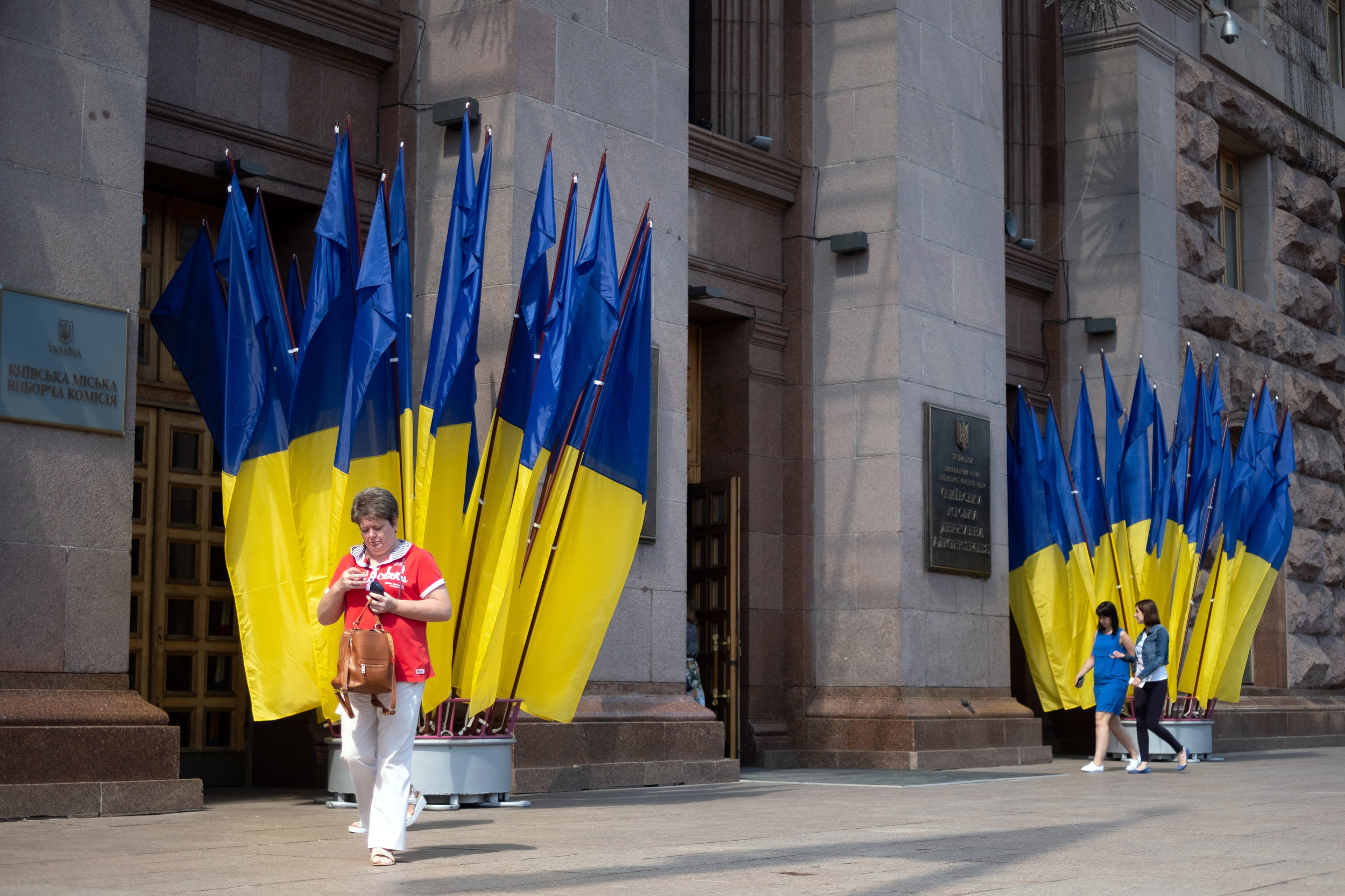 A Ukrainian woman departs from a government building in Kiev Ukraine
