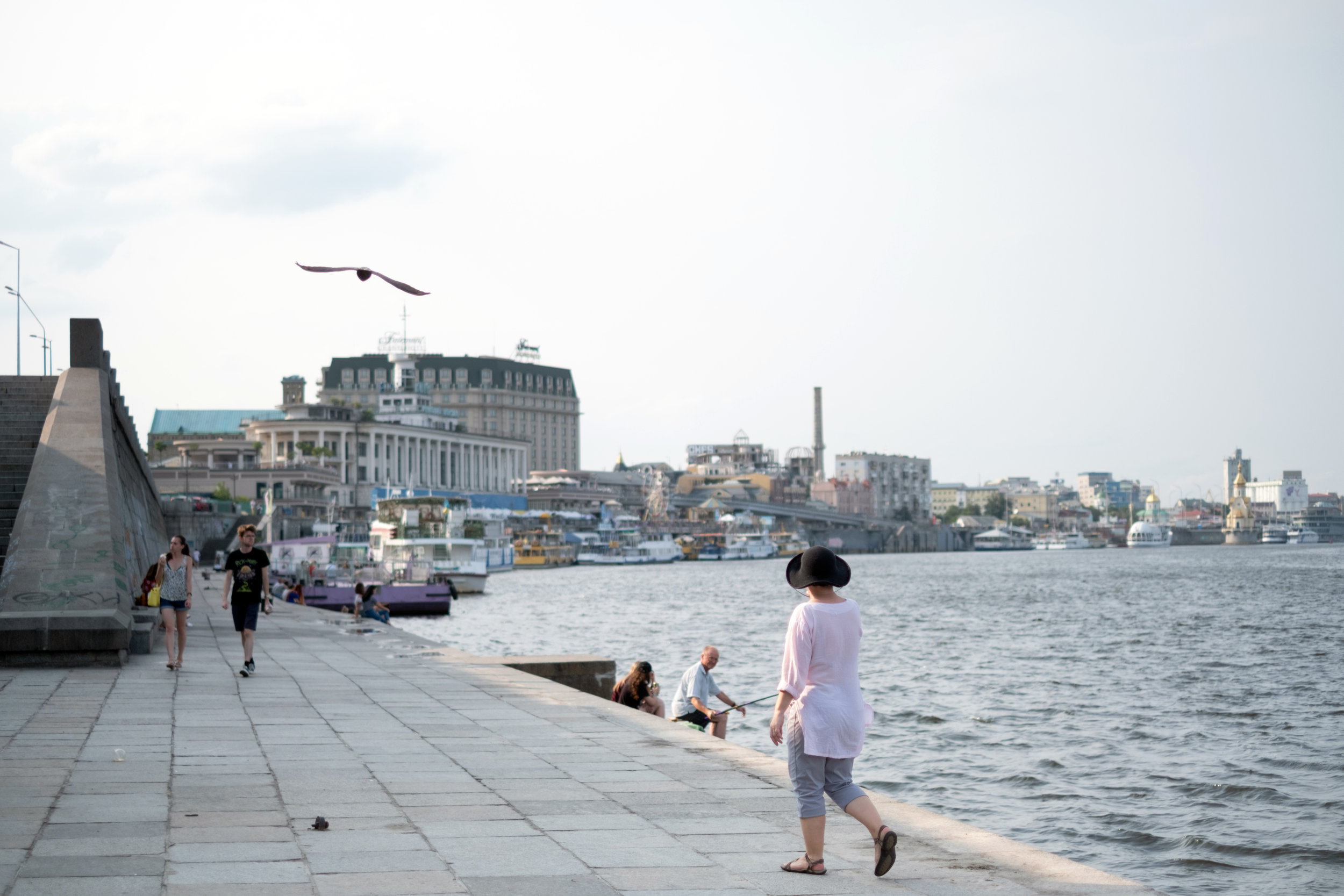 A canadian woman tourist walks along the waterfront at the harbour in Kiev Ukraine