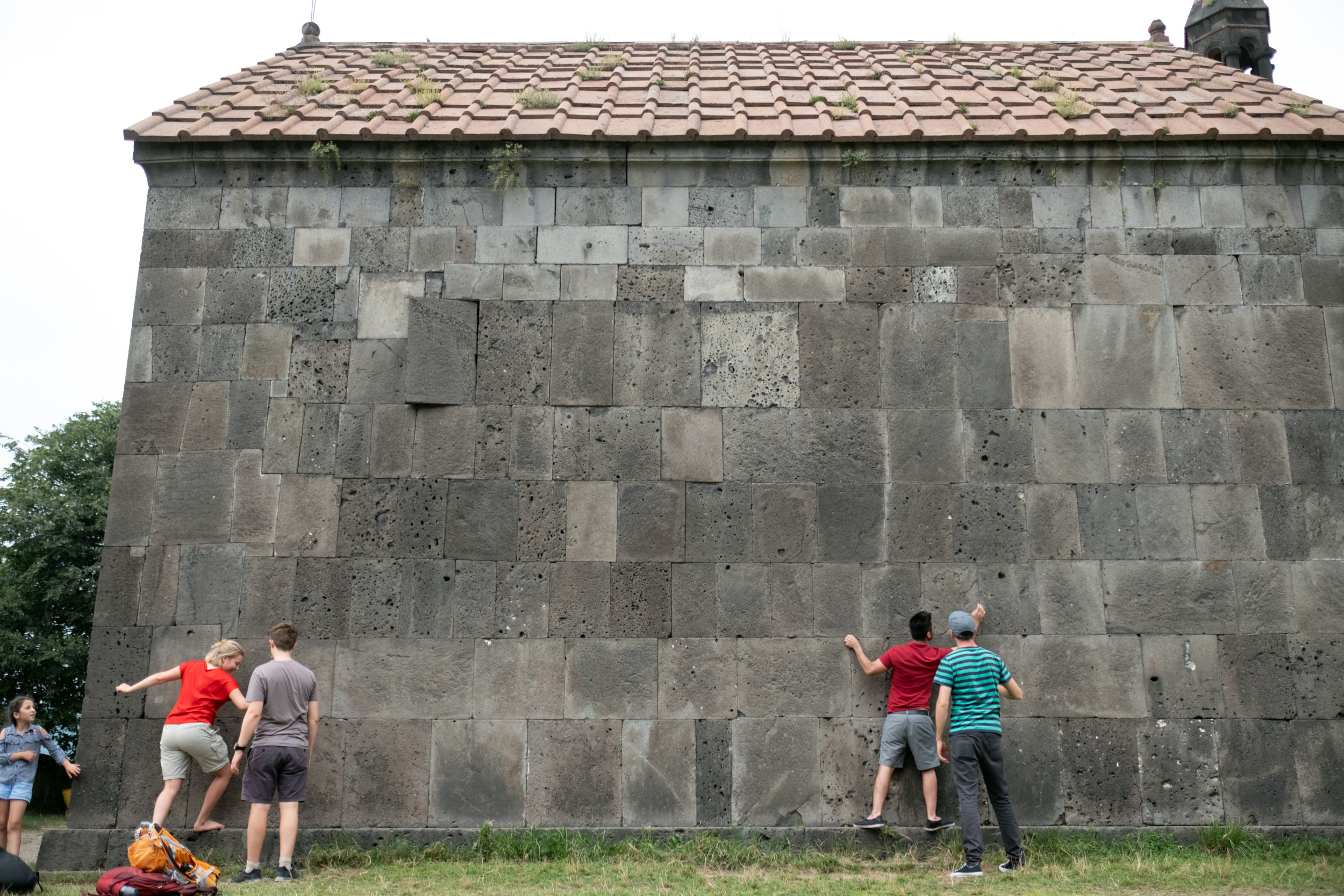 A tour group is visiting the Haghbat monastery in Armenia