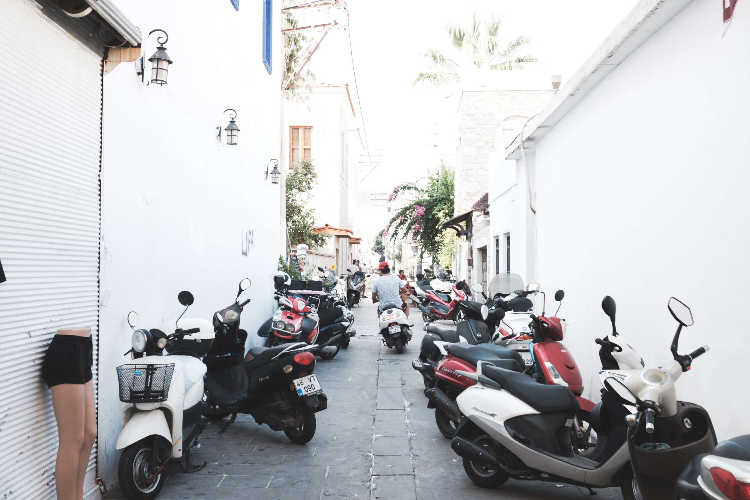 A narrow alley in Bodrum Turkey lined up with scooters