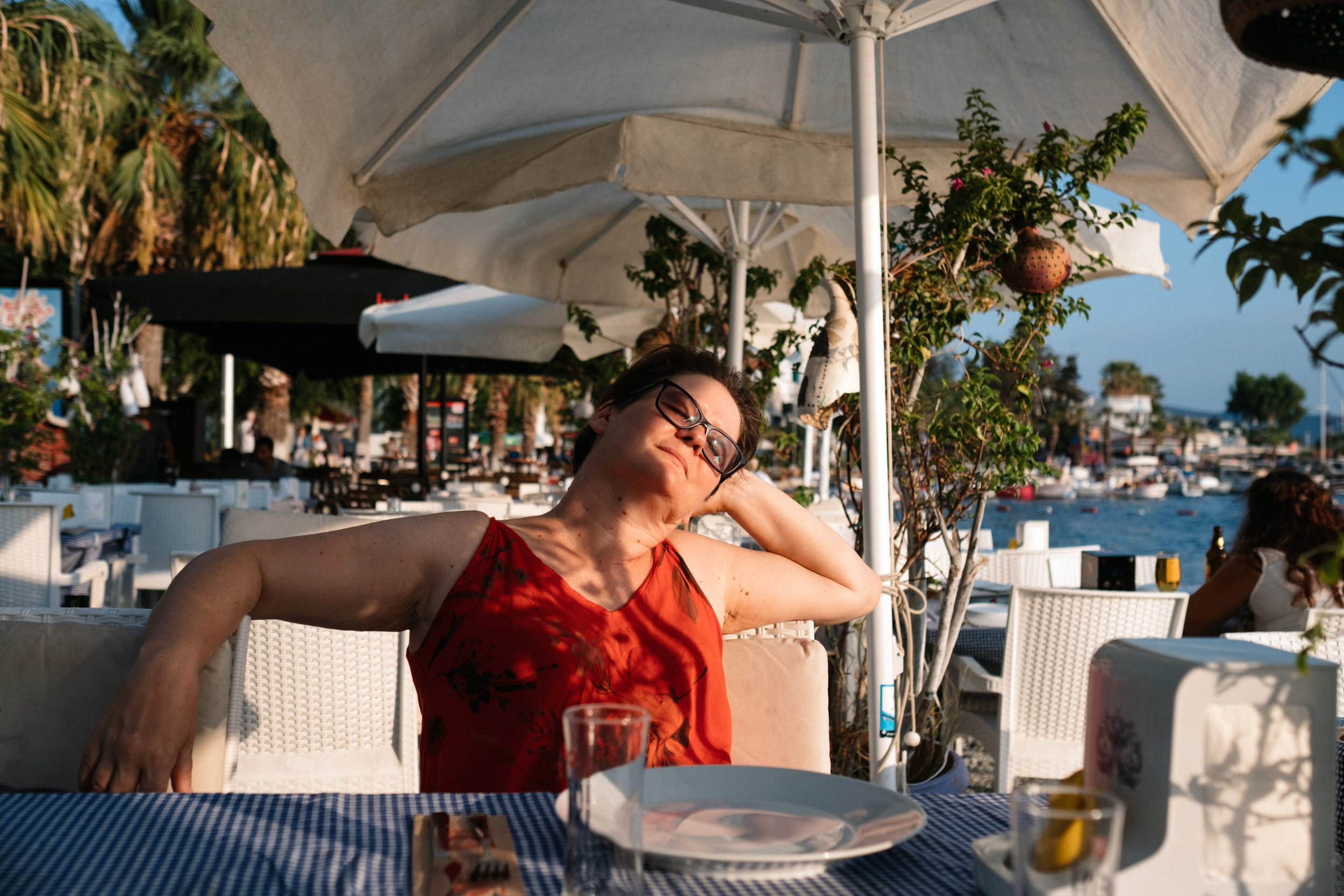 A Canadian woman, tourist, is relaxing in a beach side restaurant in Bodrum Turkey