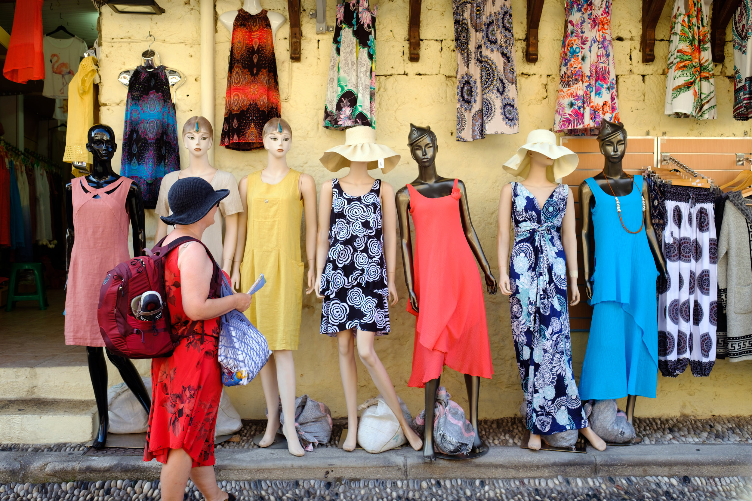 A Canadian woman shopping for dresses in Old Town Rhodes, Greece