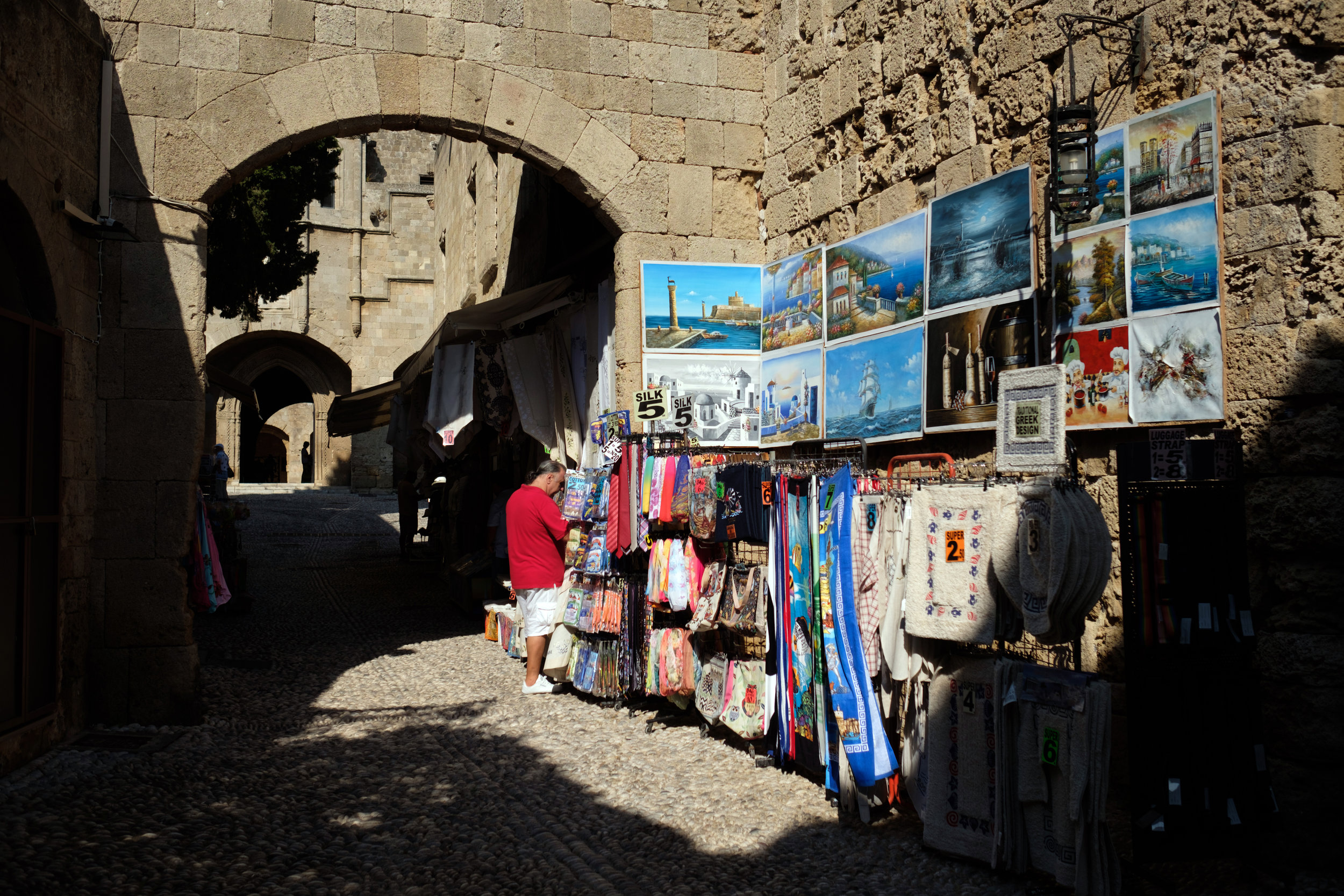 Shooping outside the Castle of the Old Town in Rhodes, Greece