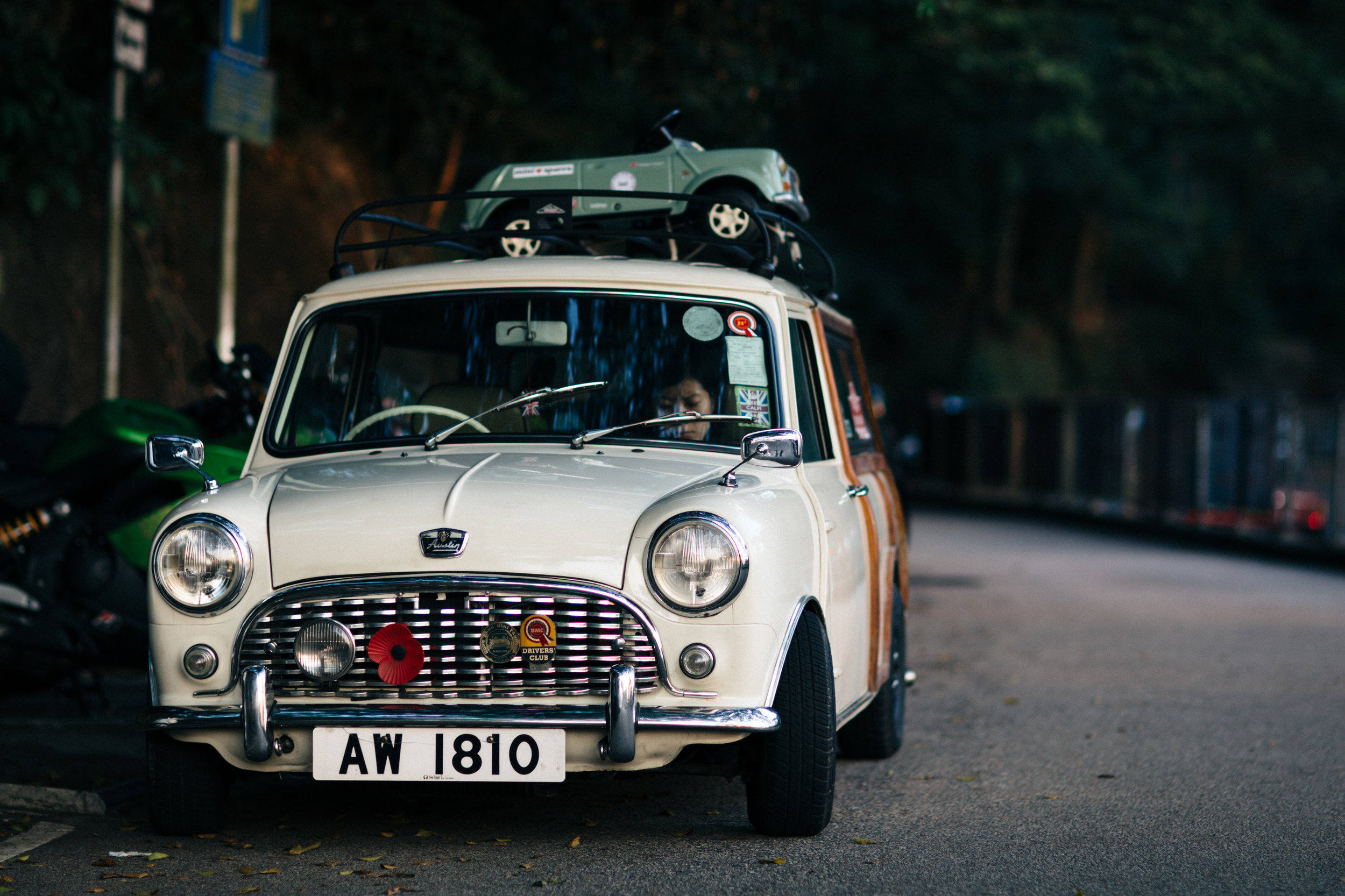 A classic white austin mini with roof rack at The Peak in Hong Kong