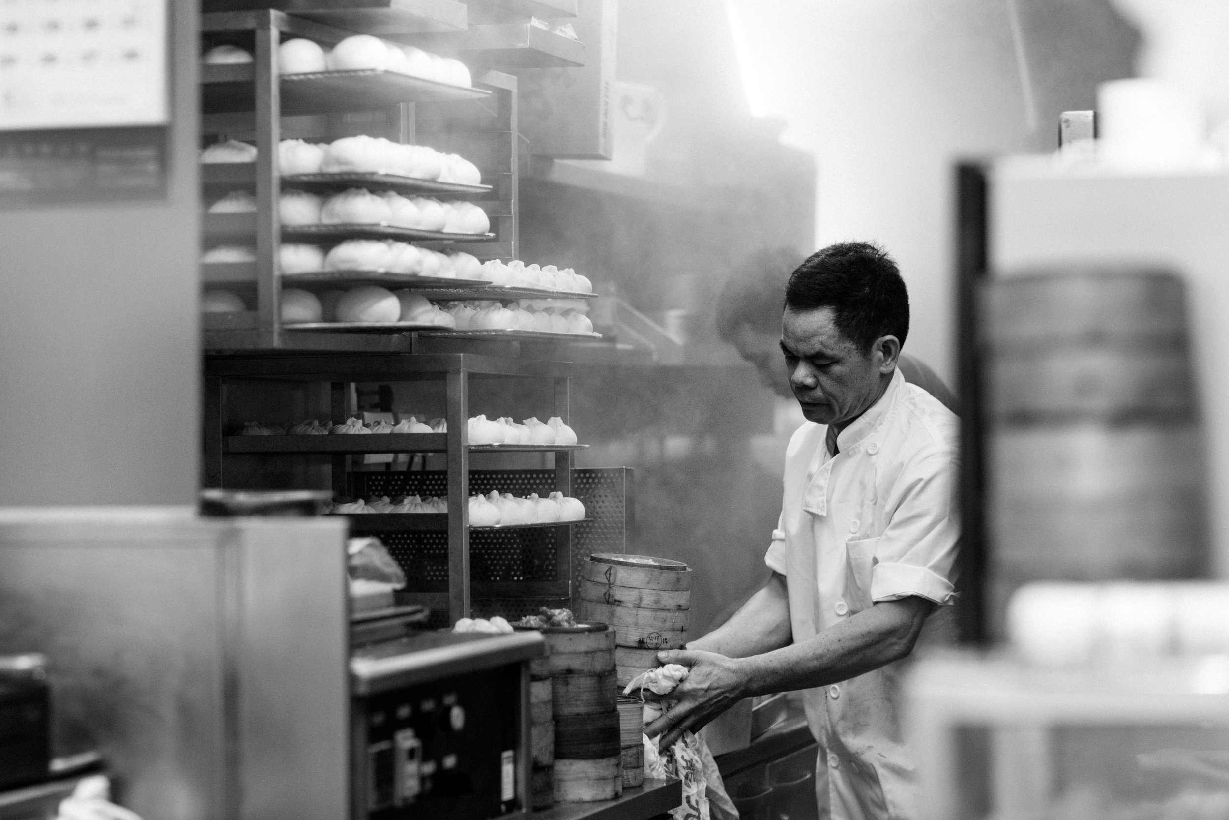 A man works in dumpling food store in food market in Wan Chai Hong Kong