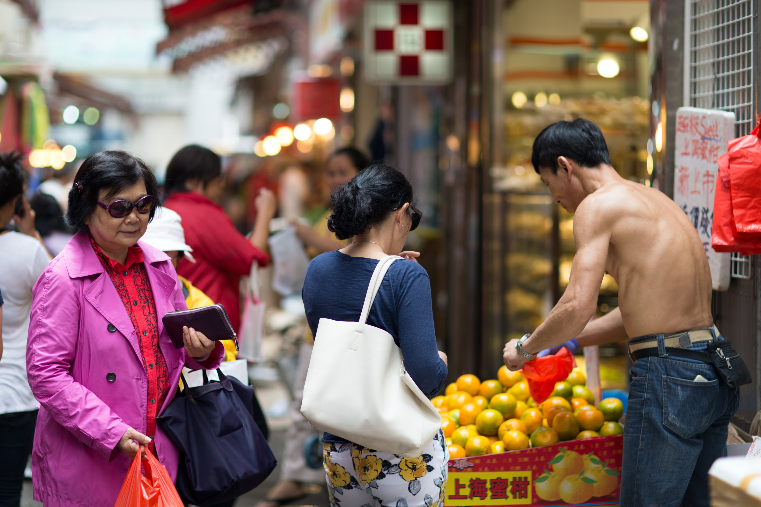 A woman buys fruit at food market in Wan Chai Hong Kong